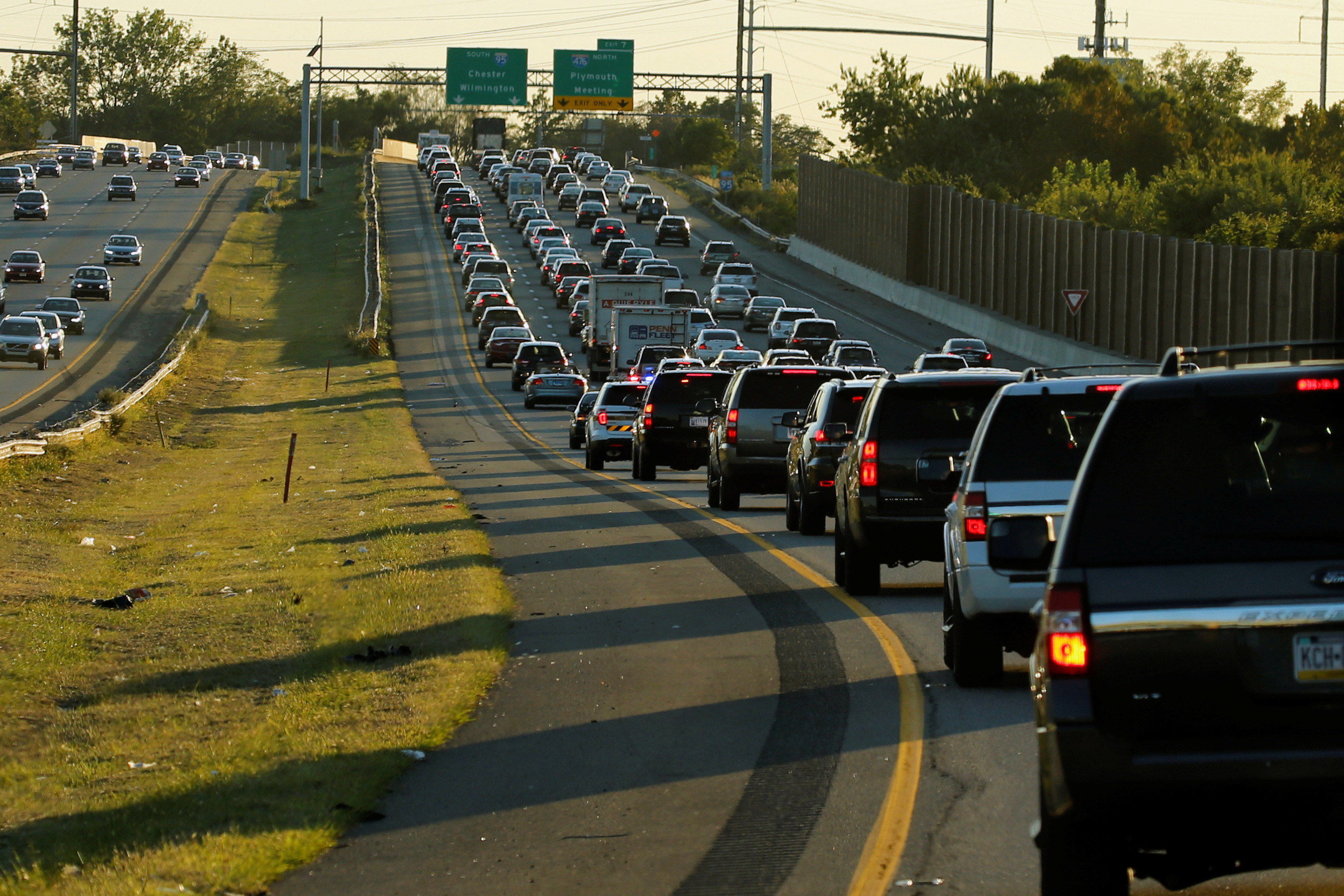 A line of SUV's making up Republican presidential nominee Donald Trump's motorcade navigate through rush hour traffic on Interstate 95 on their way to a rally with supporters in Aston, Pennsylvania, U.S. September 22, 2016. REUTERS/Jonathan Ernst - S1BEUCVYJOAA