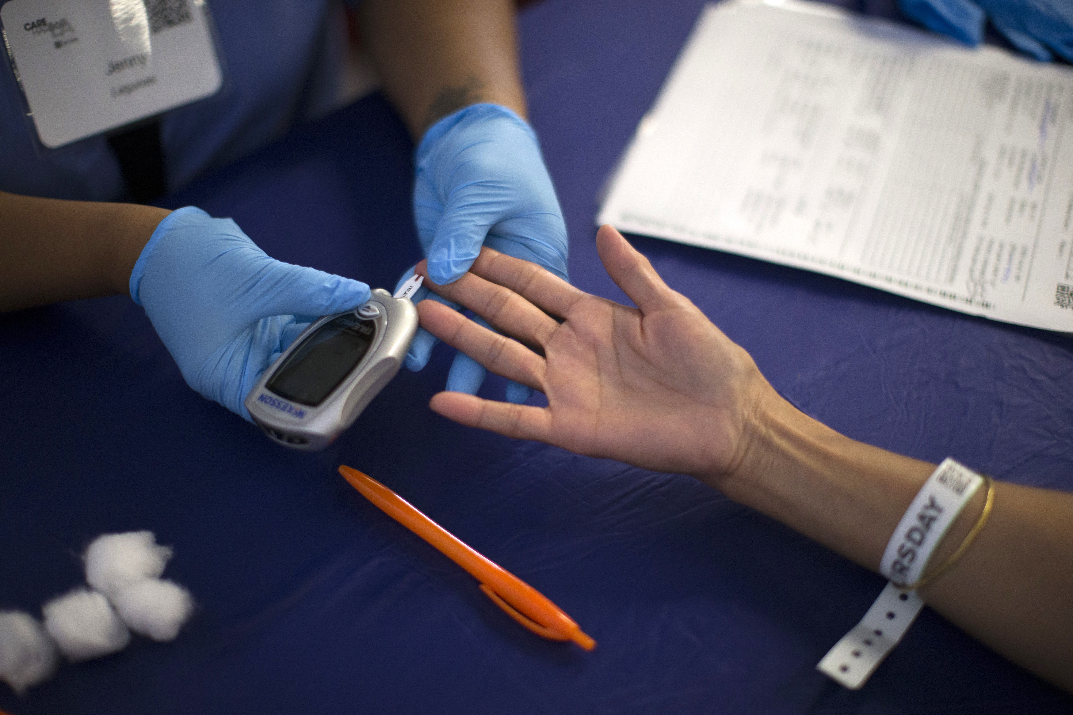 A person receives a test for diabetes.