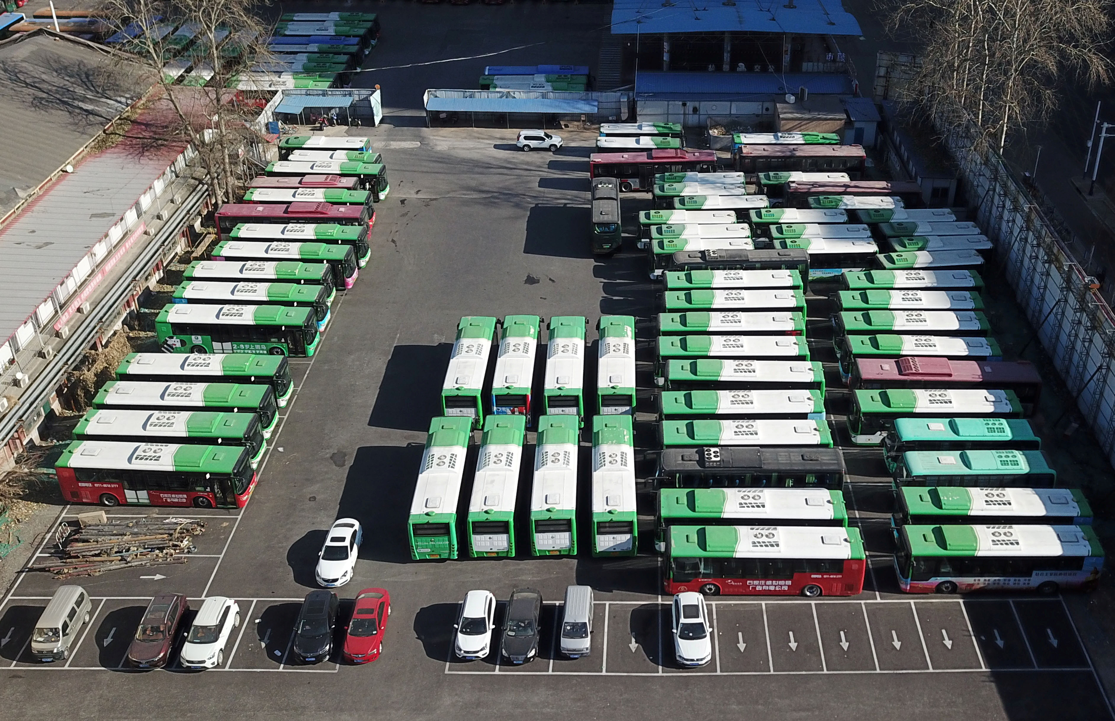 Buses are seen parked at a bus terminal in Shijiazhuang, after public transport in the city was halted following a recent outbreak of coronavirus disease (COVID-19), in Hebei province, China January 9, 2021. Picture taken with a drone. cnsphoto via REUTERS   ATTENTION EDITORS - THIS IMAGE WAS PROVIDED BY A THIRD PARTY. CHINA OUT. - RC294L9EU2IJ