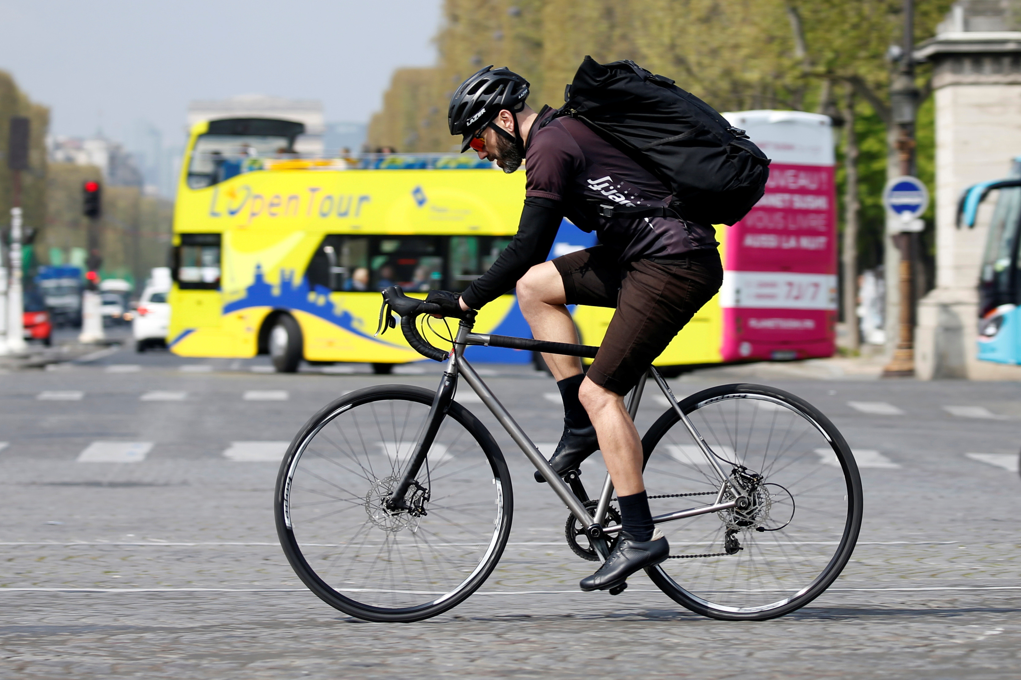 a. cycling courier delivers goods, as part of the emerging 'gig economy', in Paris, France