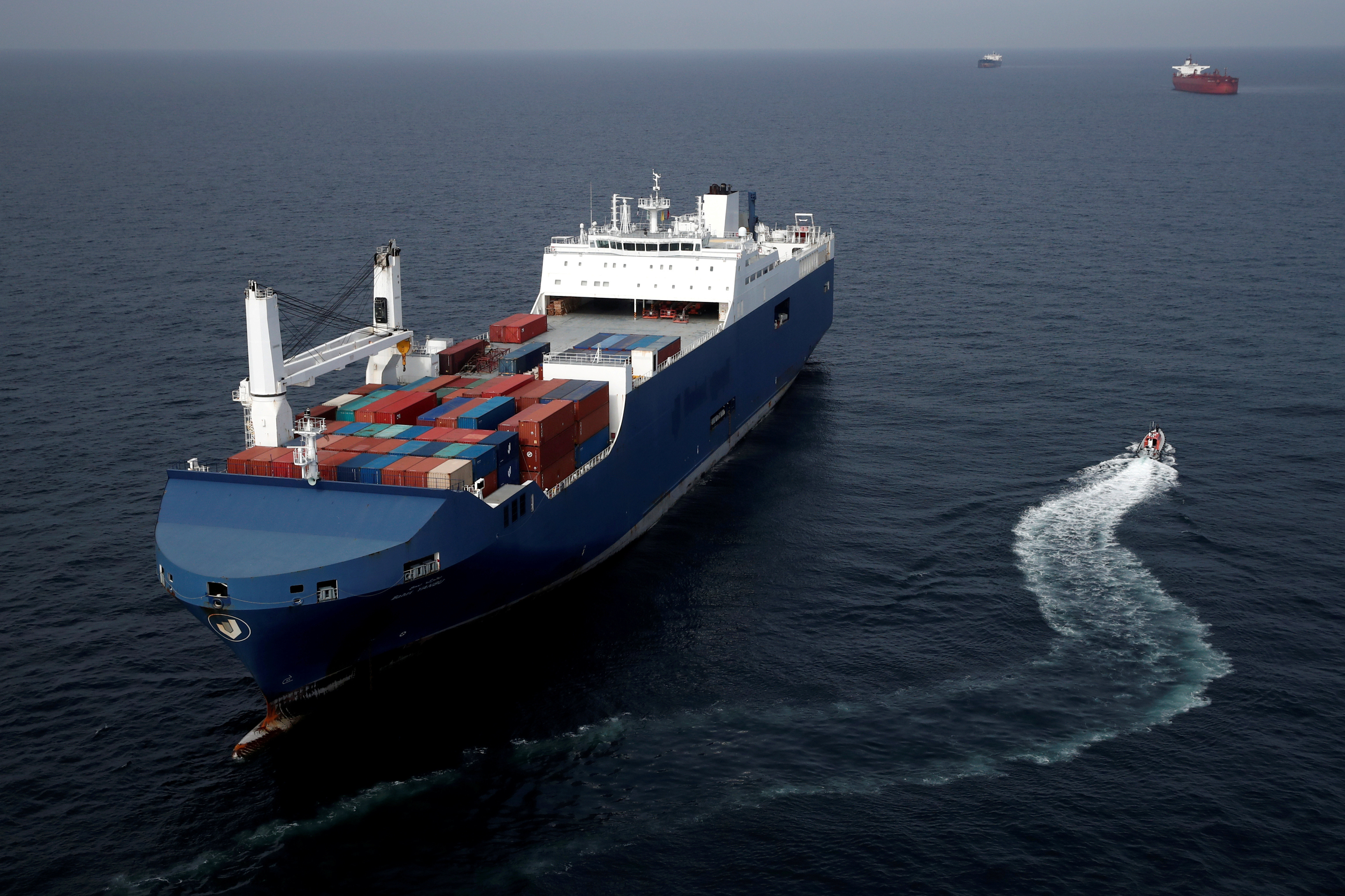 a cargo ship sails on water