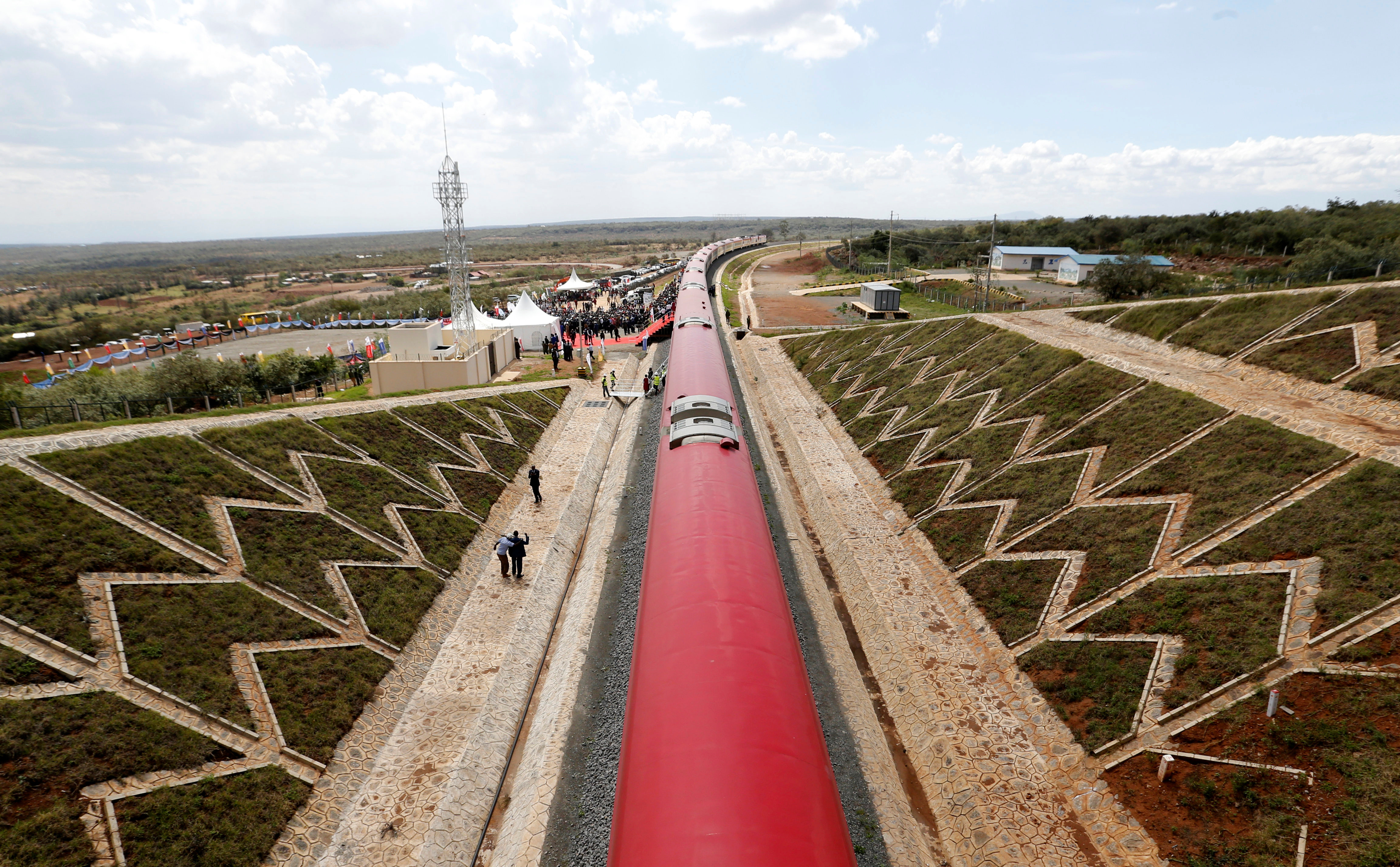 An aerial view shows a train on the Standard Gauge Railway (SGR) line constructed by the China Road and Bridge Corporation (CRBC) and financed by Chinese government in Kimuka, Kenya October 16, 2019. REUTERS/Thomas Mukoya - RC19A7D1BCE0