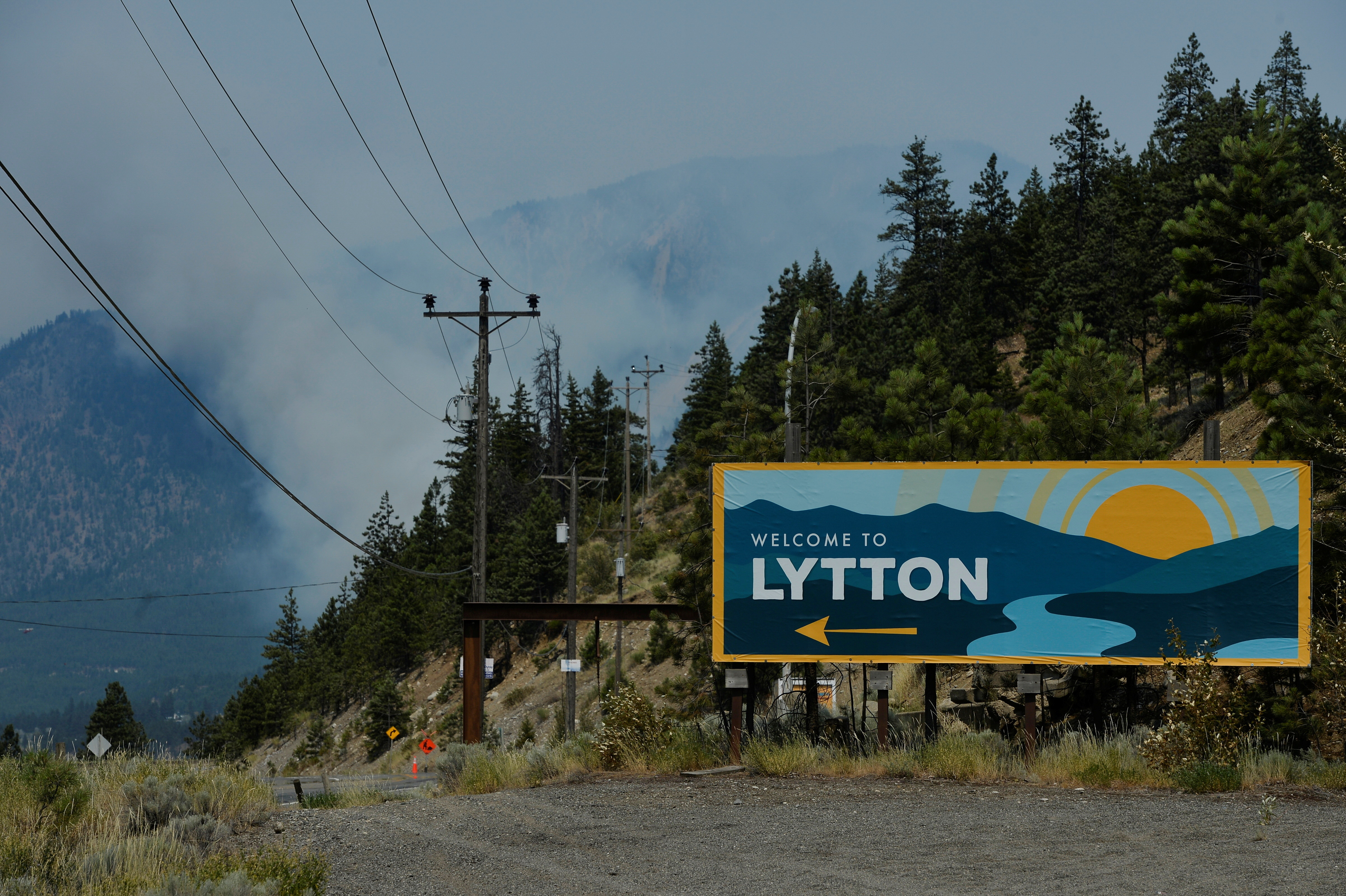 The sign for the town of Lytton, where a wildfire raged through and forced residents to evacuate, is seen in Lytton, British Columbia, Canada July 1, 2021.  REUTERS/Jennifer Gauthier - RC2PBO9GJ2NE