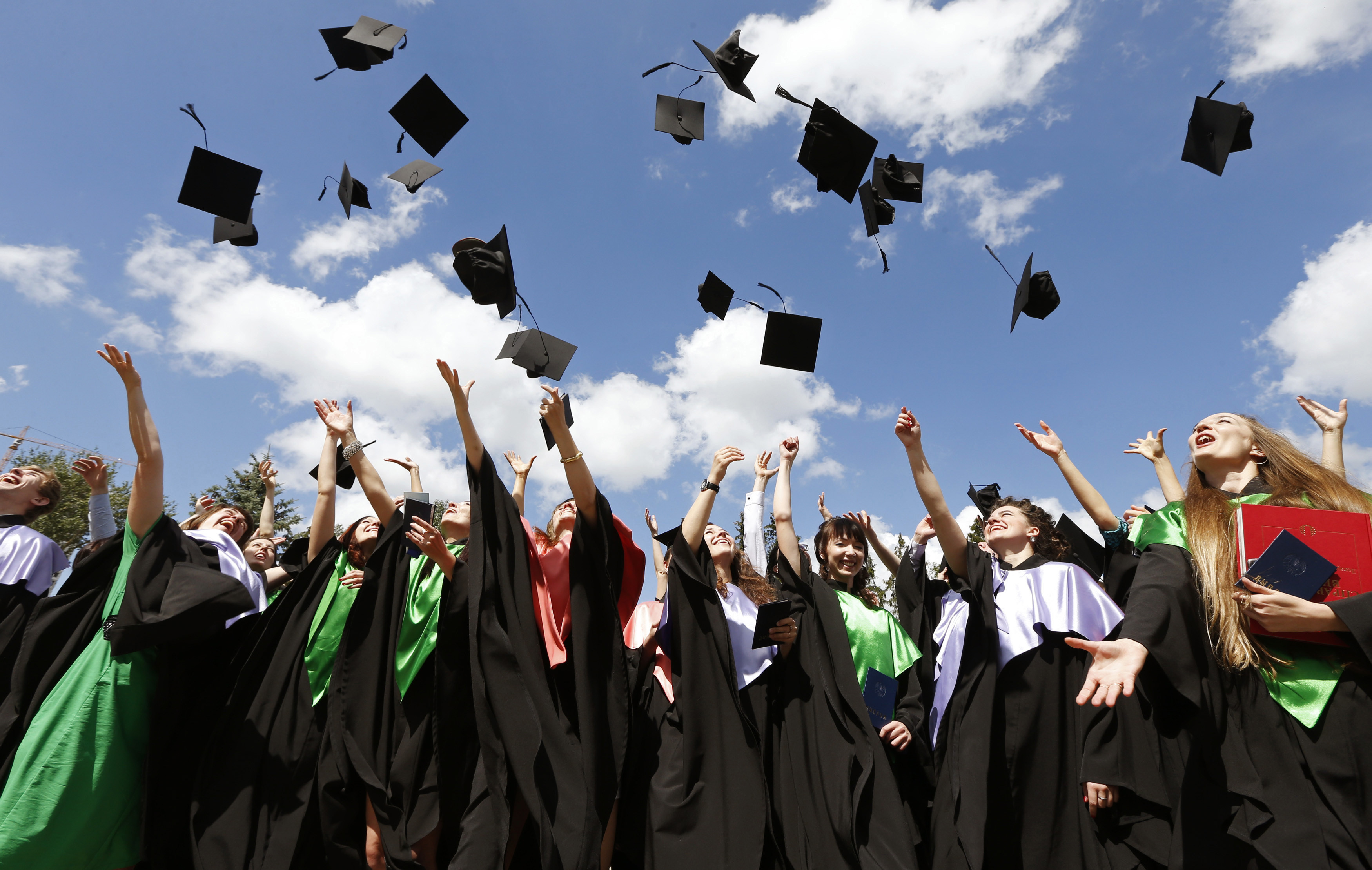 Medical University graduates throw up mortarboards during the celebration of their graduation in Minsk, June 27, 2014
