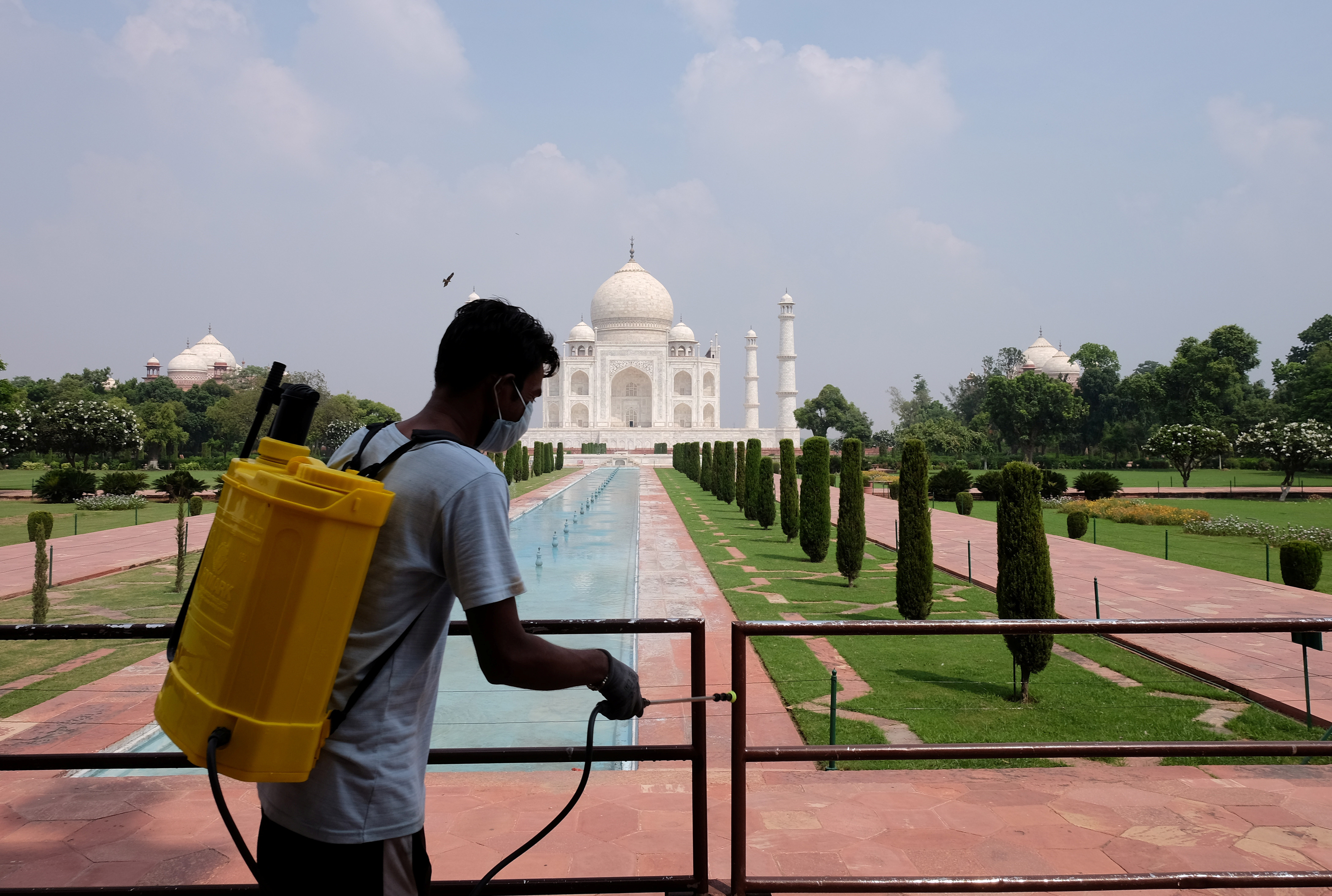 A man sanitizes railings on the Taj Mahal premises after authorities reopened the monument to visitors, amidst the coronavirus disease (COVID-19) outbreak, in Agra, India, September 21, 2020.