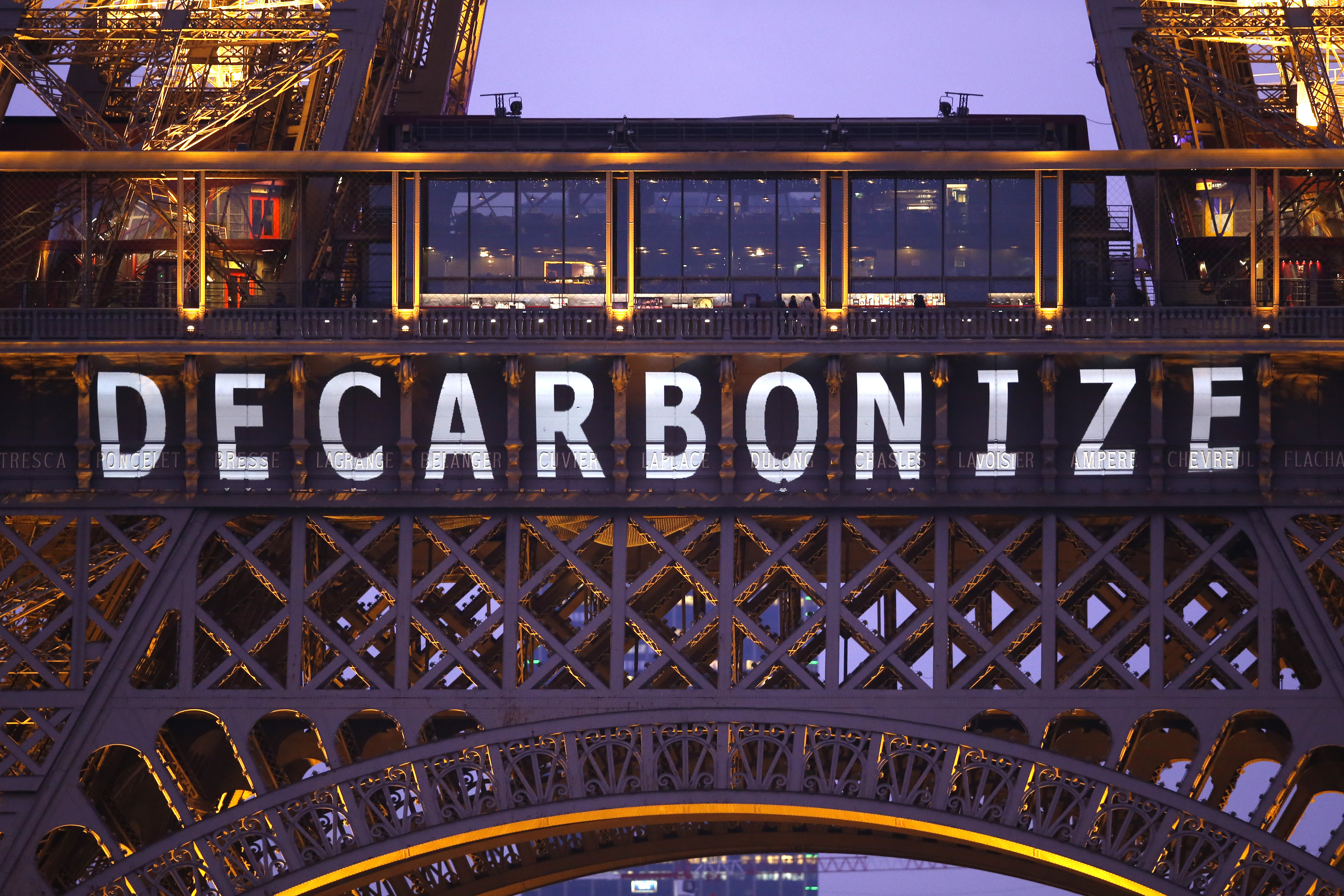 """The slogan """"Decarbonize"""" is projected on the Eiffel Tower as part of the World Climate Change Conference 2015 (COP21) in Paris, France, December 11, 2015.   REUTERS/Charles Platiau - LR1EBCB1BVQ2S"""