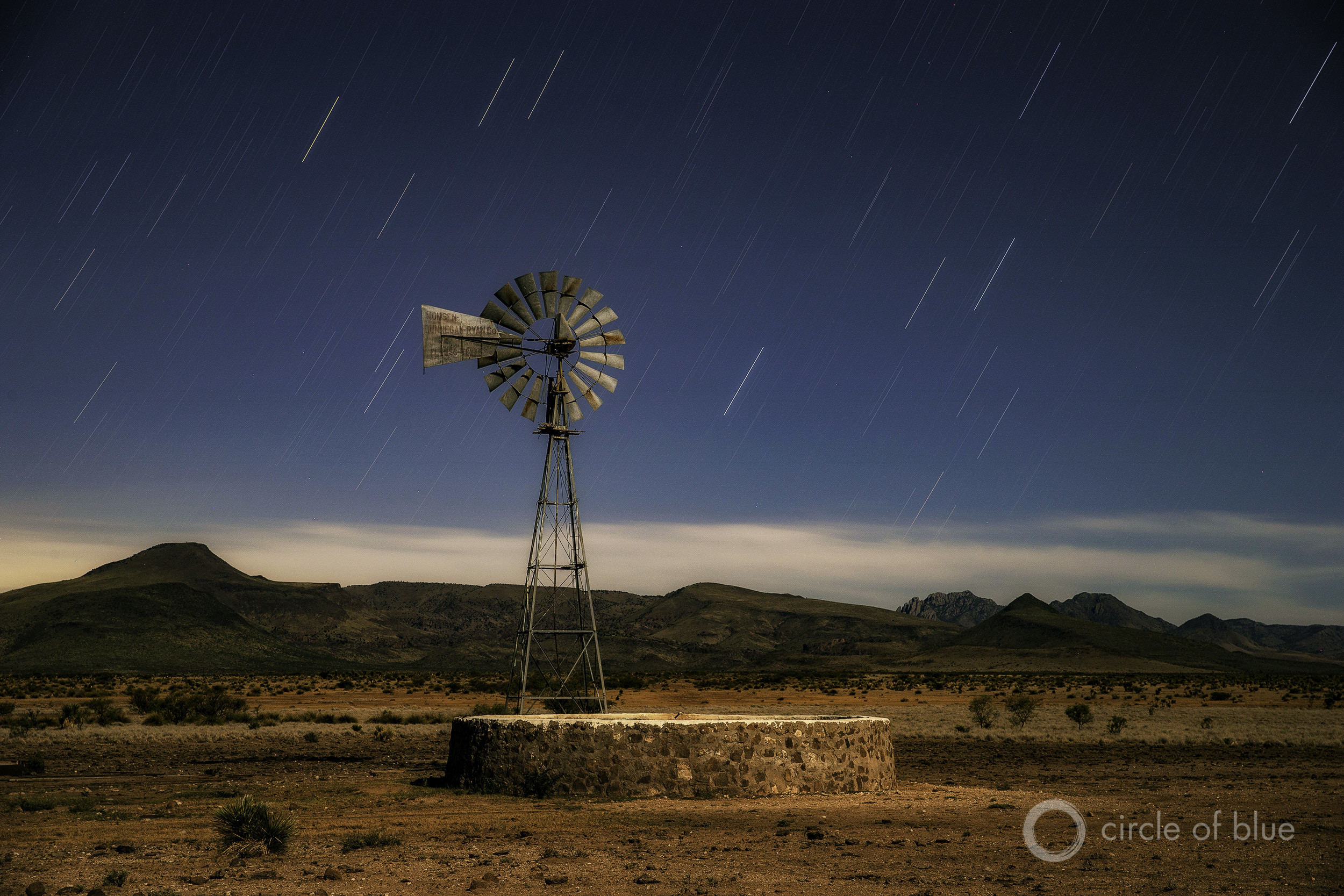 A windmill on the land of Bodie Means, 68, near Valentine, Texas. The Davis Mountain Range is in the background.