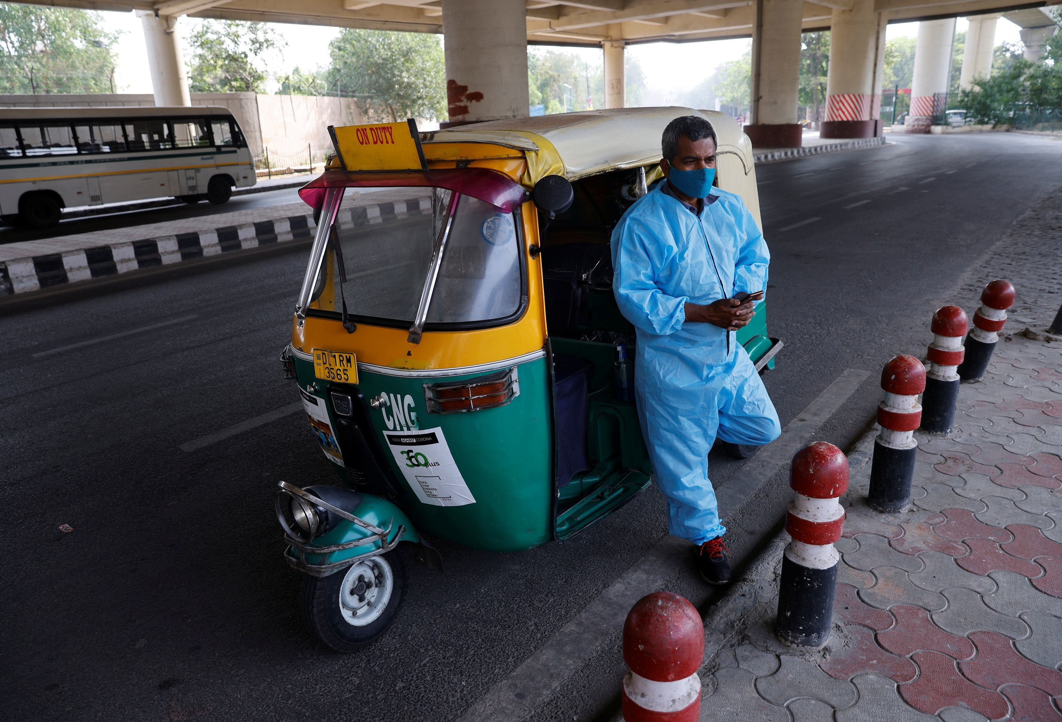 Raj Kumar, 42, a driver of an auto rickshaw ambulance which is prepared to transfer people suffering from the coronavirus disease (COVID-19) and their relatives for free, waits for passengers in New Delhi, India May 6, 2021. REUTERS/Adnan Abidi - RC23AN94AM13