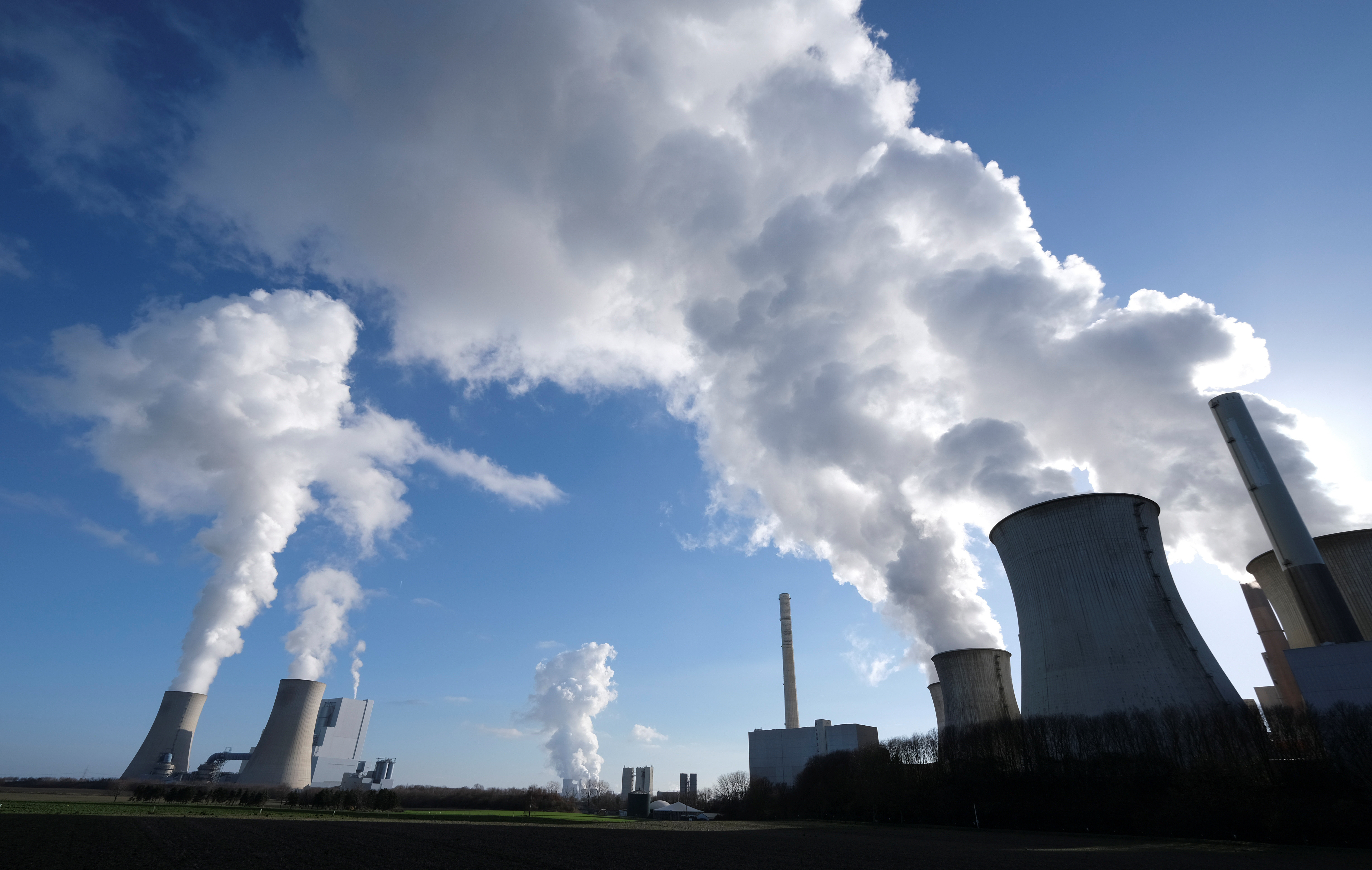 """The lignite power plants of """"Neurath New"""", Niederaussem, and """"Neurath Old"""" of German energy supplier and utility RWE are pictured in Neurath, north-west of Cologne, Germany, February 5, 2020."""