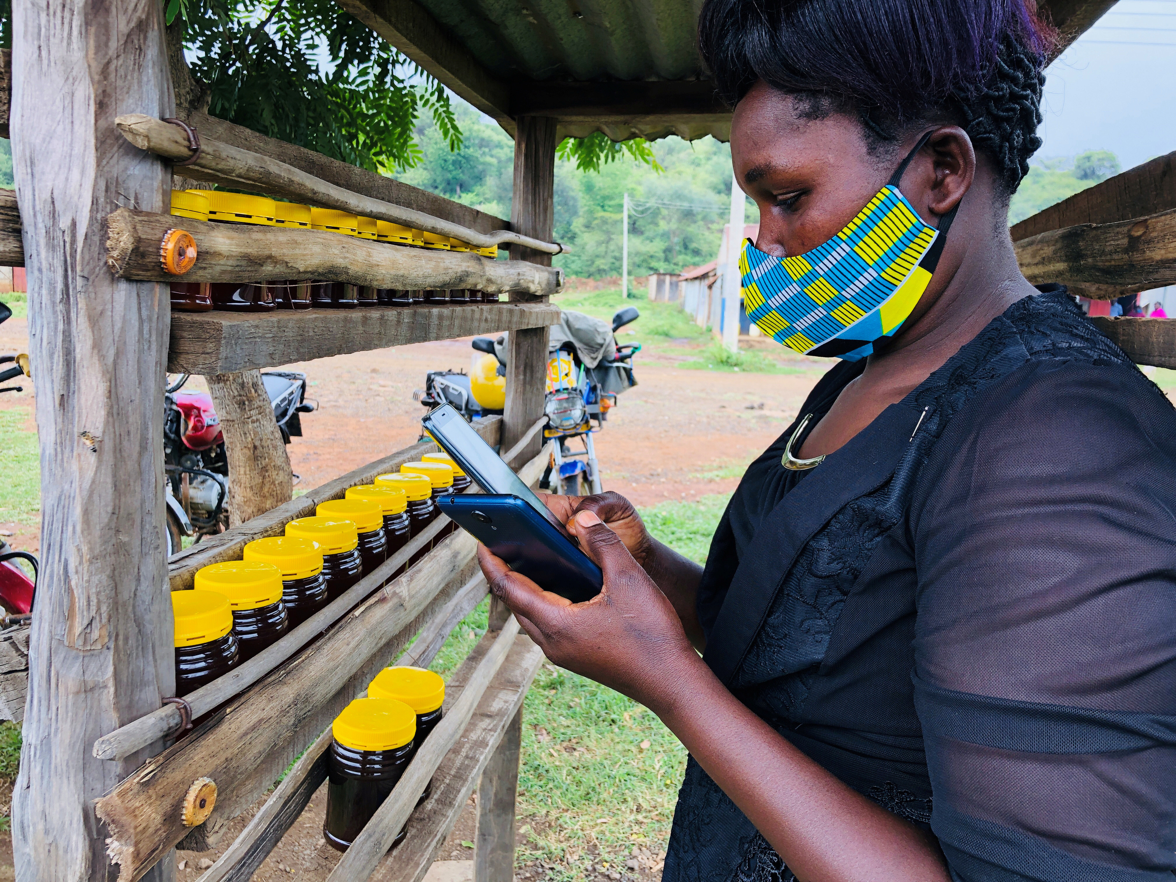 Dorcas Kipkeroi, a honey vendor uses her cell phone to test the Loon technology internet via video call as Alphabet Inc begins offering the world's first commercial high-speed internet using balloons to villagers in Radad, Baringo County, Kenya July 8, 2020. REUTERS/Jackson Njehia - RC22PH9Z5DUJ