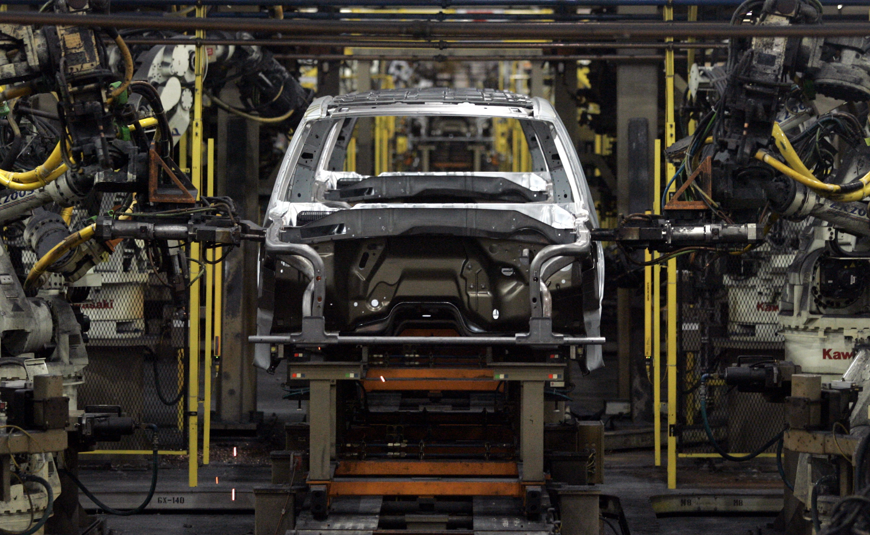 robots work on Ford Expedition and Lincoln Navigator SUV frames on the assembly line at Ford Motor Michigan Truck Plant in Wayne, Michigan