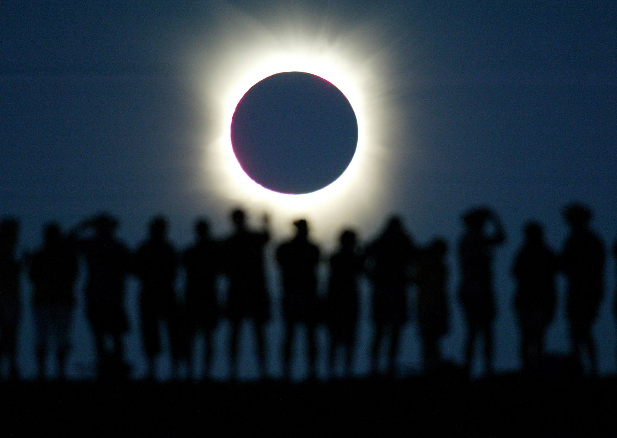 Tourists watch the sun being blocked by the moon during a solar eclipsein the Australian outback town of Lyndhurst, located around 700kilometres (437 miles) north of Adelaide December 4, 2002. The town isone of only four in Australia where the 26 second-long full eclipse ofthe sun could be seen and occurred during celebrations for the Year ofthe Outback. The shadow path of whats called totality, where the'diamond ring' effect becomes visible, can be seen on a path that isjust 36 kilometres wide. REUTERS/David GrayDG/CP - RP3DRHXWXYAA