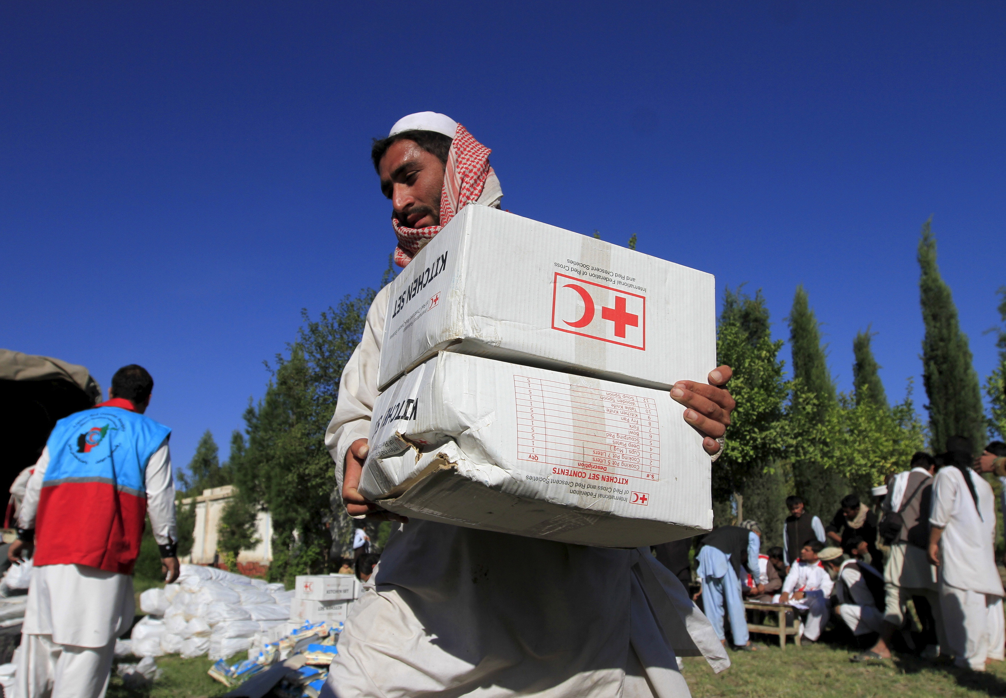 An Afghan man receives aid from the International Federation of the Red Cross and Red Crescent Societies after an earthquake, in Behsud district of Jalalabad province, Afghanistan October 28, 2015. The Taliban urged aid agencies on Tuesday to push ahead in delivering emergency relief supplies after a major earthquake hit remote mountainous regions of northern Afghanistan and Pakistan. Relief groups' efforts to assess the damage were hindered by an unstable security situation that has left much of the affected areas unsafe for international aid workers and government troops. But the Taliban, which have stepped up their Islamist insurgency against the Western-backed government in Kabul this year, indicated they would not stand in the way of aid efforts.