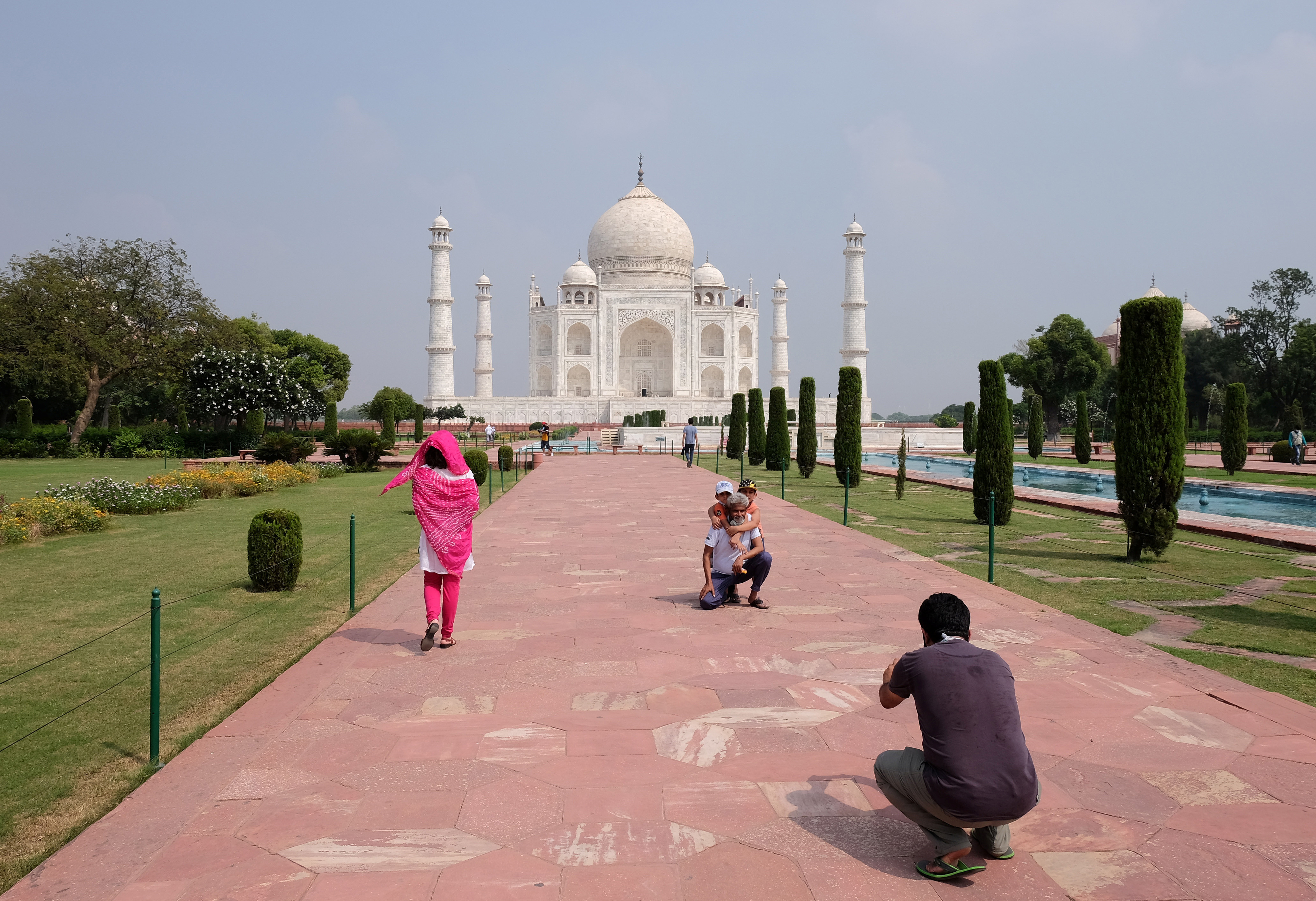 A man gets his photograph taken in front of Taj Mahal after authorities reopened the monument to visitors, amidst the coronavirus disease (COVID-19) outbreak, in Agra, India, September 21, 2020. REUTERS/Alasdair Pal