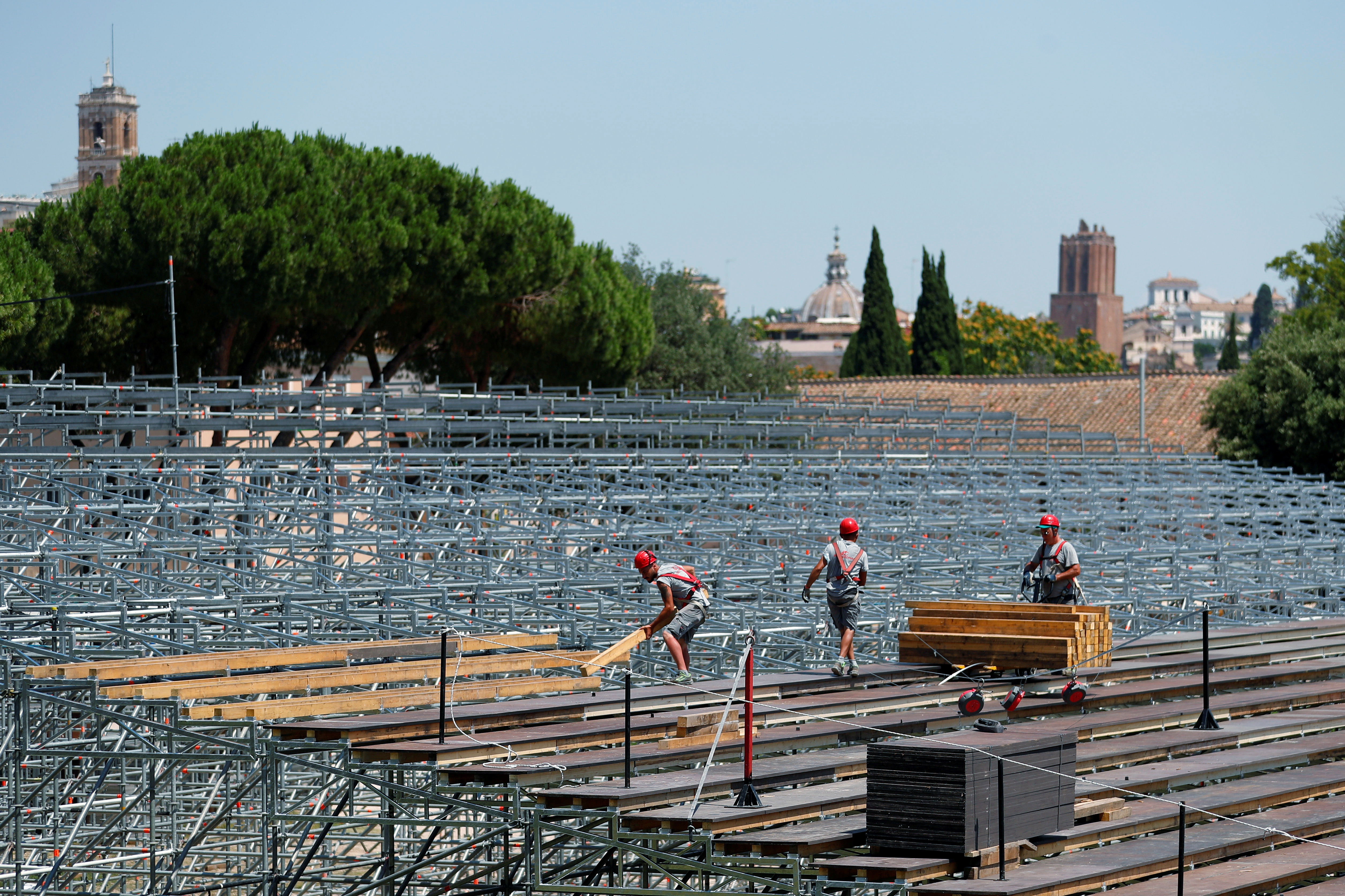 Workers build a seating area for socially distanced Rome Opera House's summer performances at Circus Maximus, the ancient chariot racetrack, following the coronavirus disease (COVID-19) outbreak in Rome, Italy, June 25, 2020. Picture taken June 25, 2020. REUTERS/Guglielmo Mangiapane - RC2BSH9A8NIX