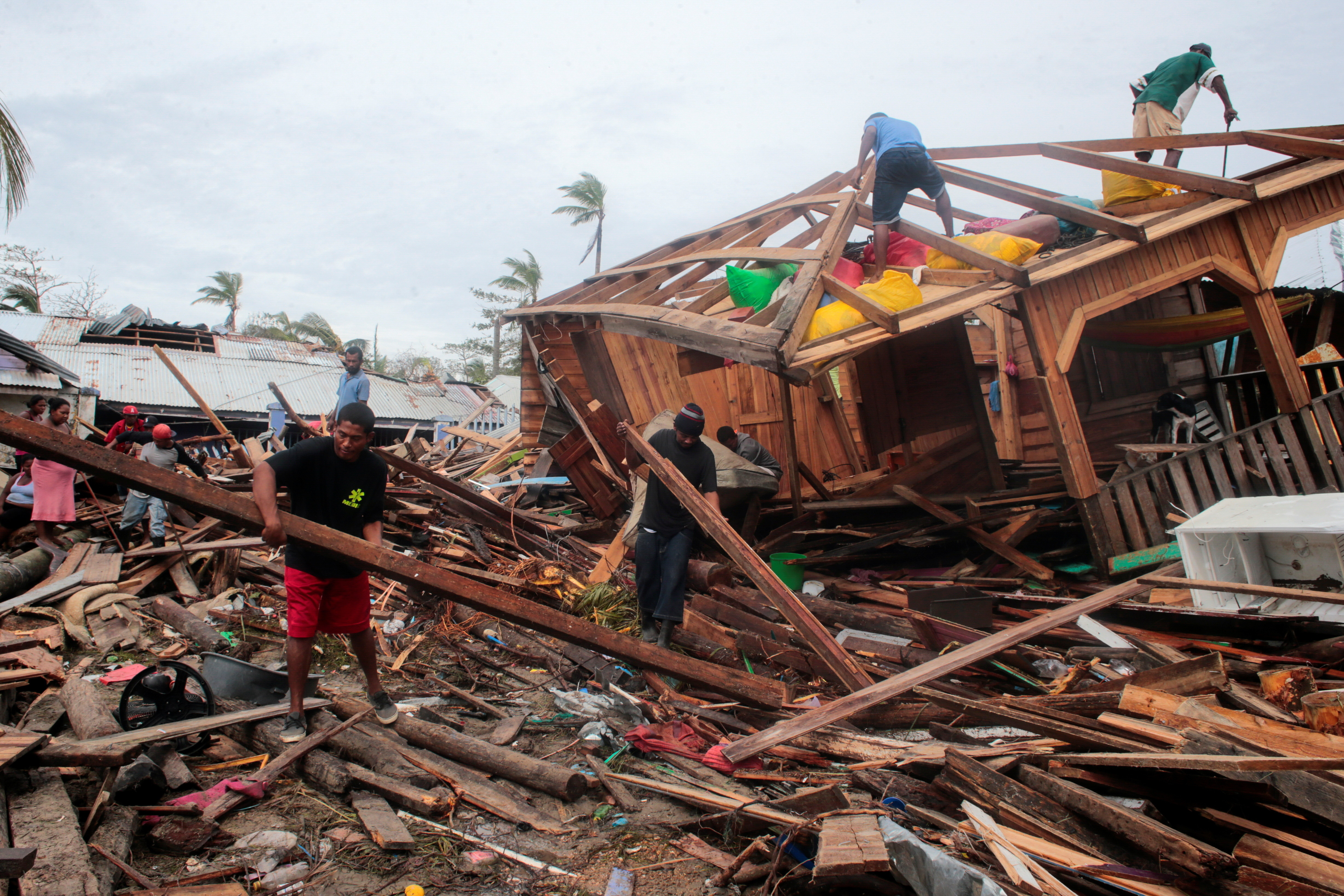 Residents remove debris from their houses destroyed by the passing of Hurricane Iota, in Puerto Cabezas, Nicaragua November 18, 2020.