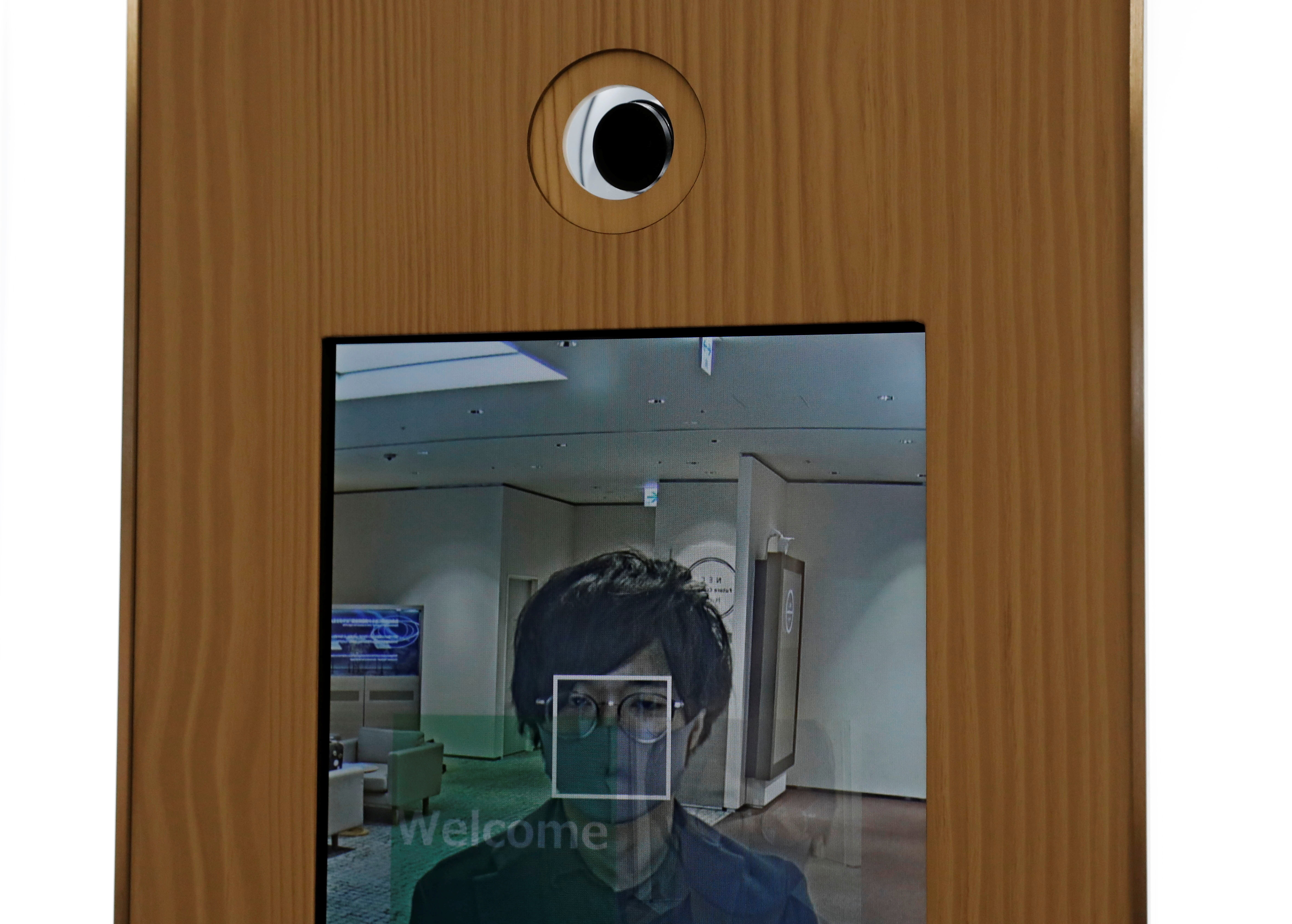 A camera and a monitor for a facial recognition system that identifies people even when they are wearing masks, is pictured as NEC's Shinya Takashima demonstrates the system, amid the coronavirus disease (COVID-19) outbreak, at its headquarters in Tokyo, Japan, January 6, 2021. Picture taken on January 6, 2021.  REUTERS/Kim Kyung-Hoon - RC2R2L9JVBK8