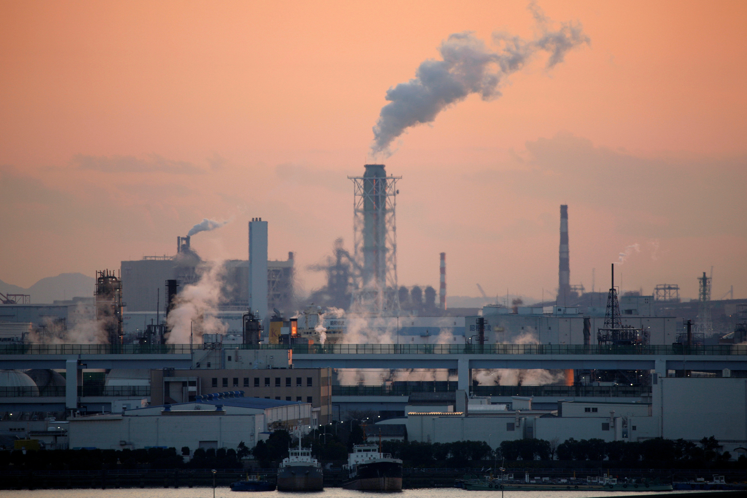 Factories are seen near Tokyo. The coronavirus pandemic may have caused structural changes in Japan's economy, requiring the Bank of Japan to tap more deeply into big data in making policy decisions, its top economist said. Non-traditional data, such as credit card spending, smartphone usage and even air pollution levels can capture real-time changes in economies. REUTERS/Stringer - RC2BUH9FAWCK