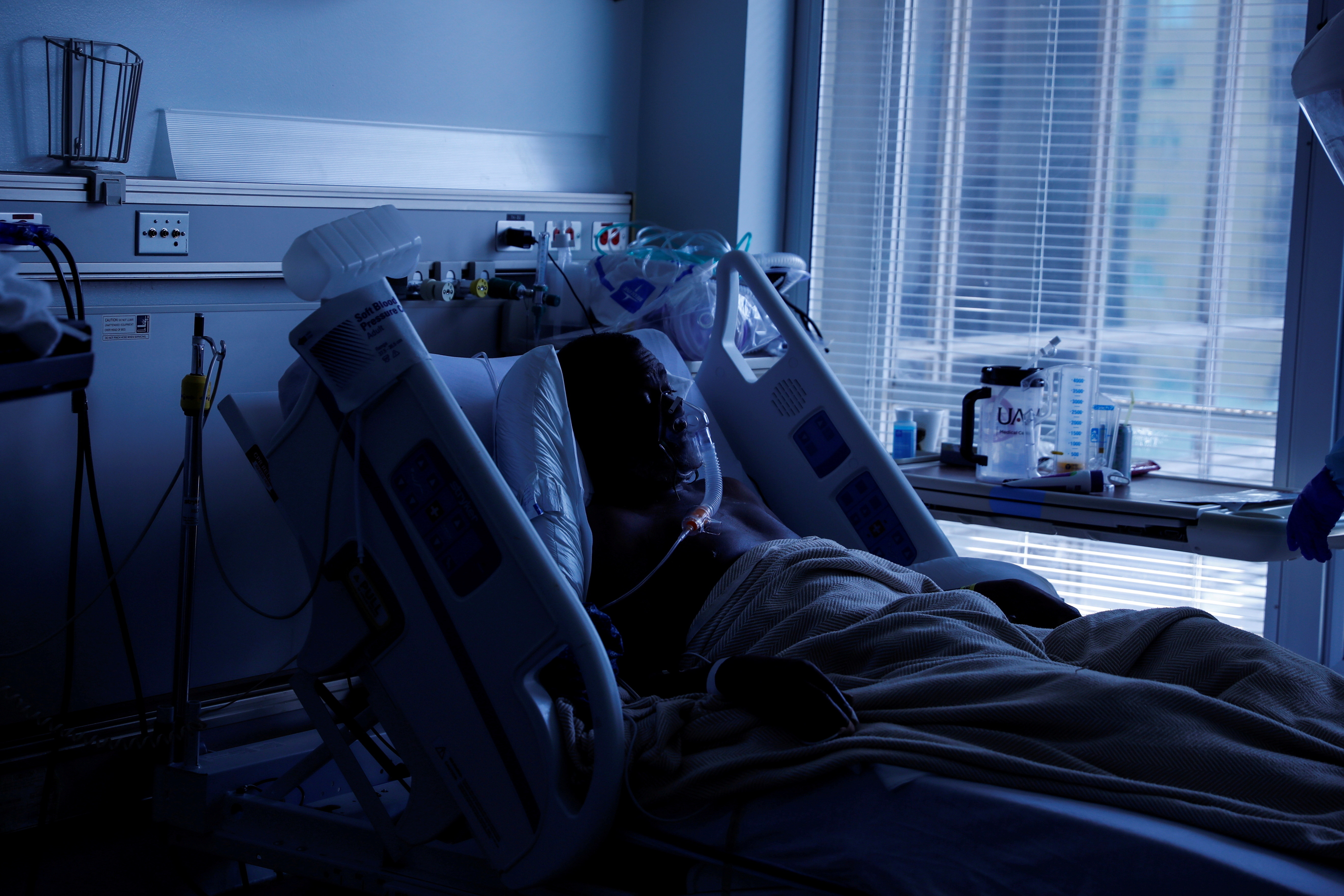 Boris Bryant, a (COVID-19) positive patient, lays in his isolation room on the Covid-19 unit at University of Arkansas for Medical Sciences (UAMS) in Little Rock, Arkansas, U.S., August 16, 2021. REUTERS/Shannon Stapleton     TPX IMAGES OF THE DAY - RC2E6P9WSD2D