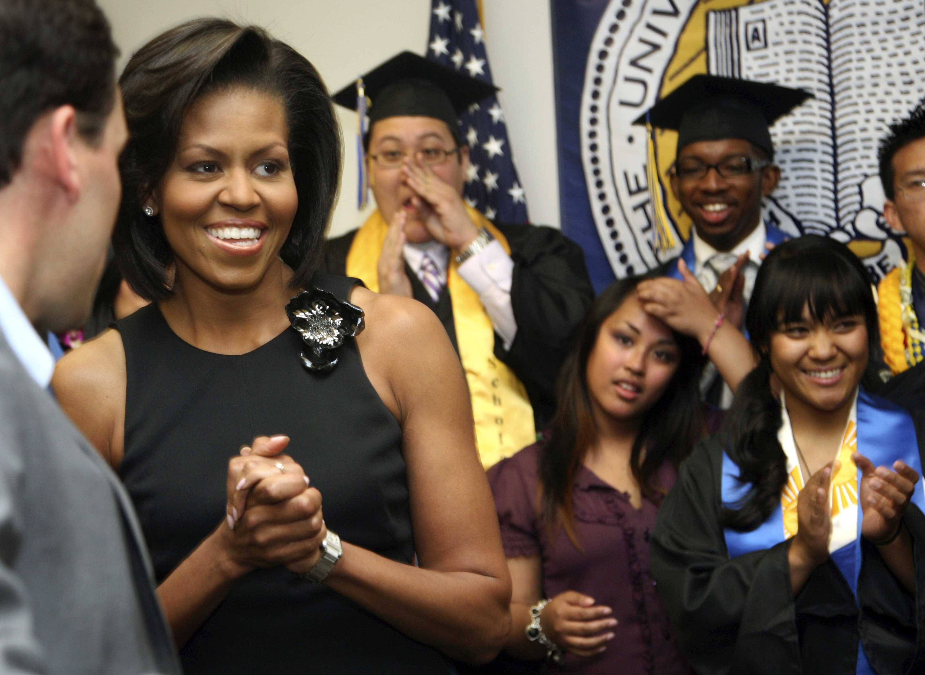 Then US First Lady Michelle Obama talks with graduating students prior to during her address at the University of California Merced in Merced, California  in 2009