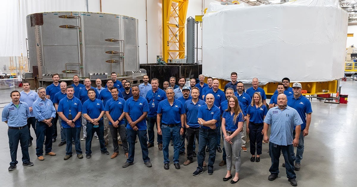 image shows the first section of the giant magnet wrapped and ready to leave California for France, with the team who built it.