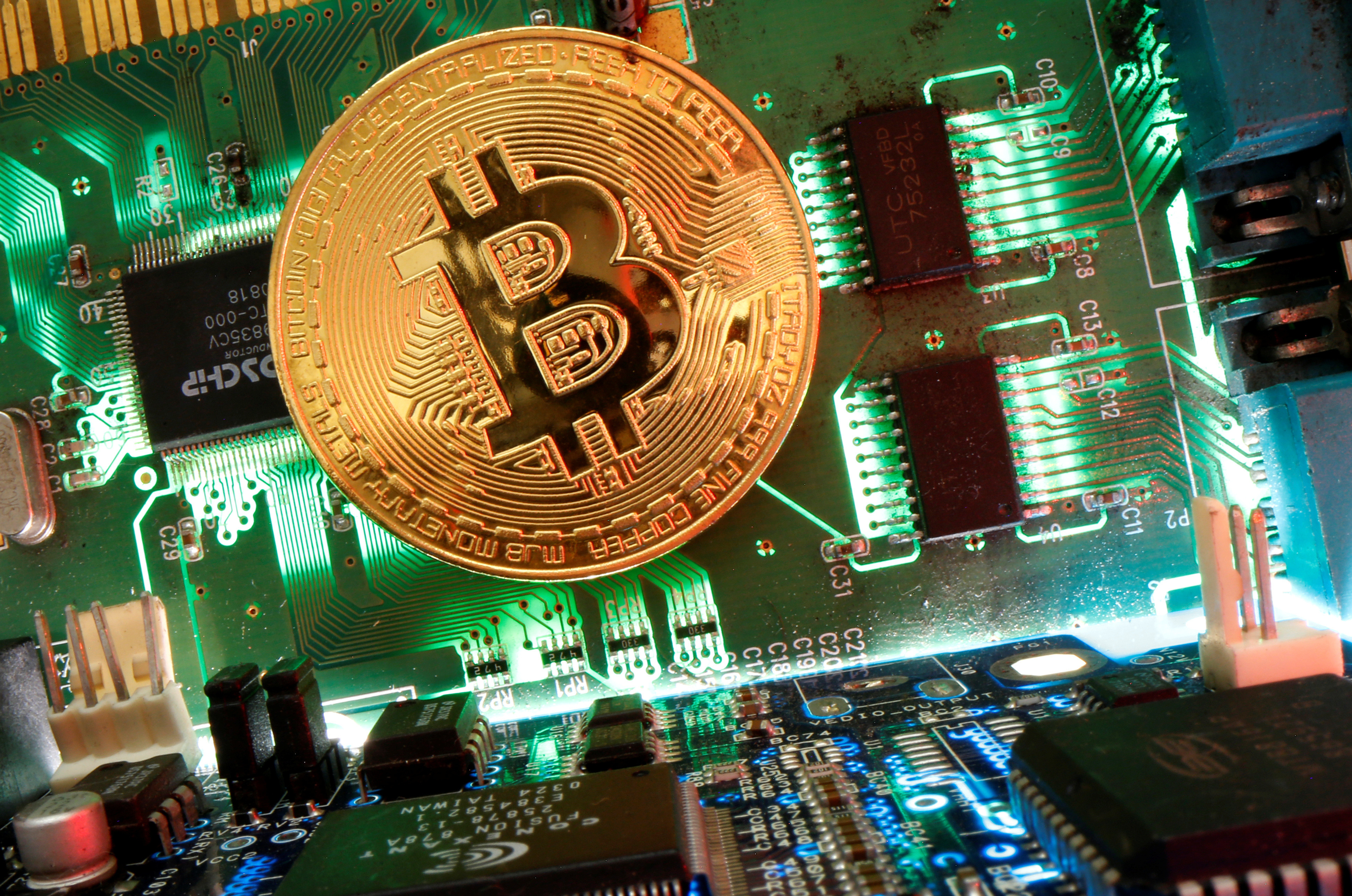 Representation of the virtual currency Bitcoin is seen on a motherboard in this picture illustration taken April 24, 2020. REUTERS/Dado Ruvic /Illustration - RC22BG916B8I