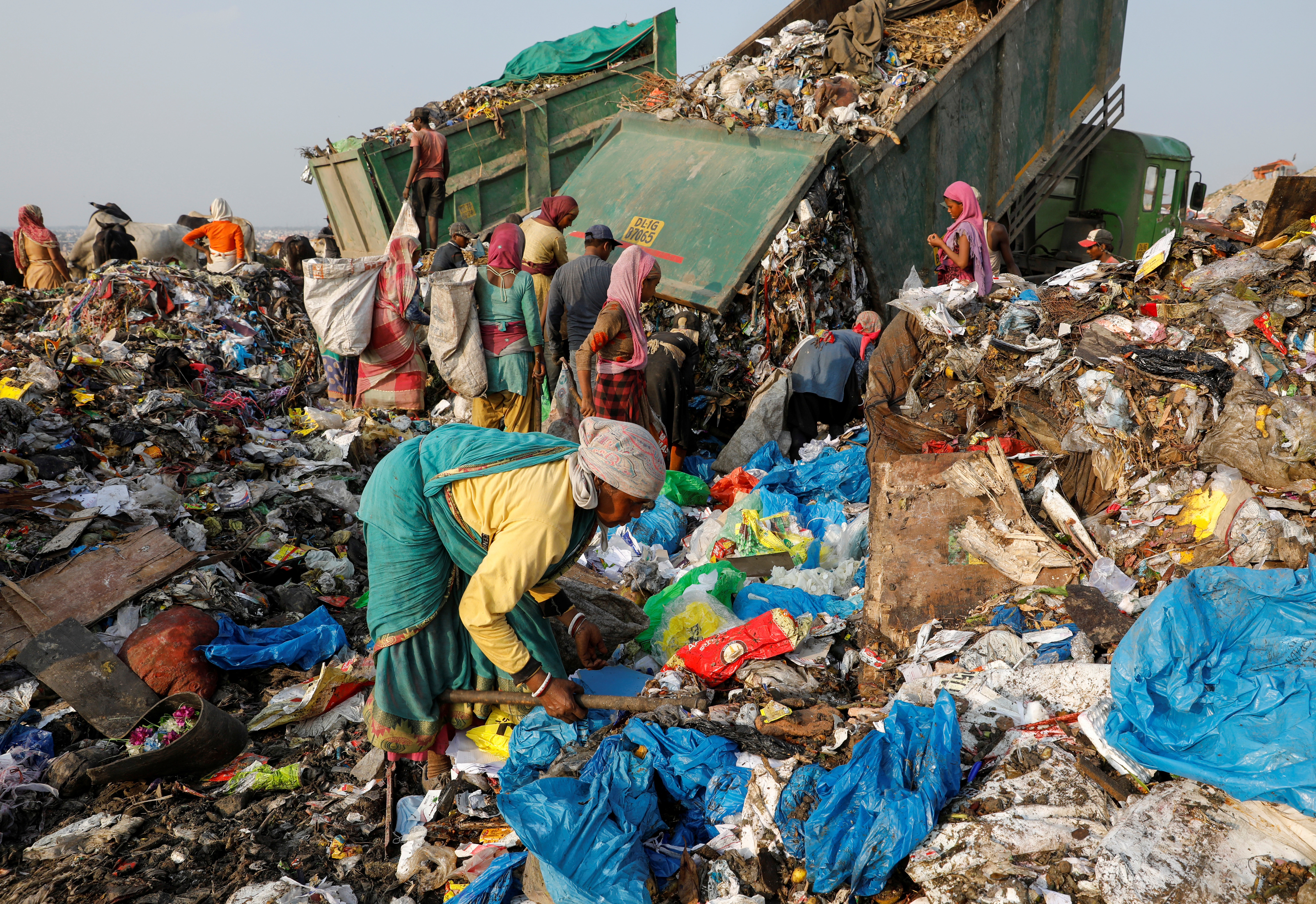 image of waste collectors at a landfill in India