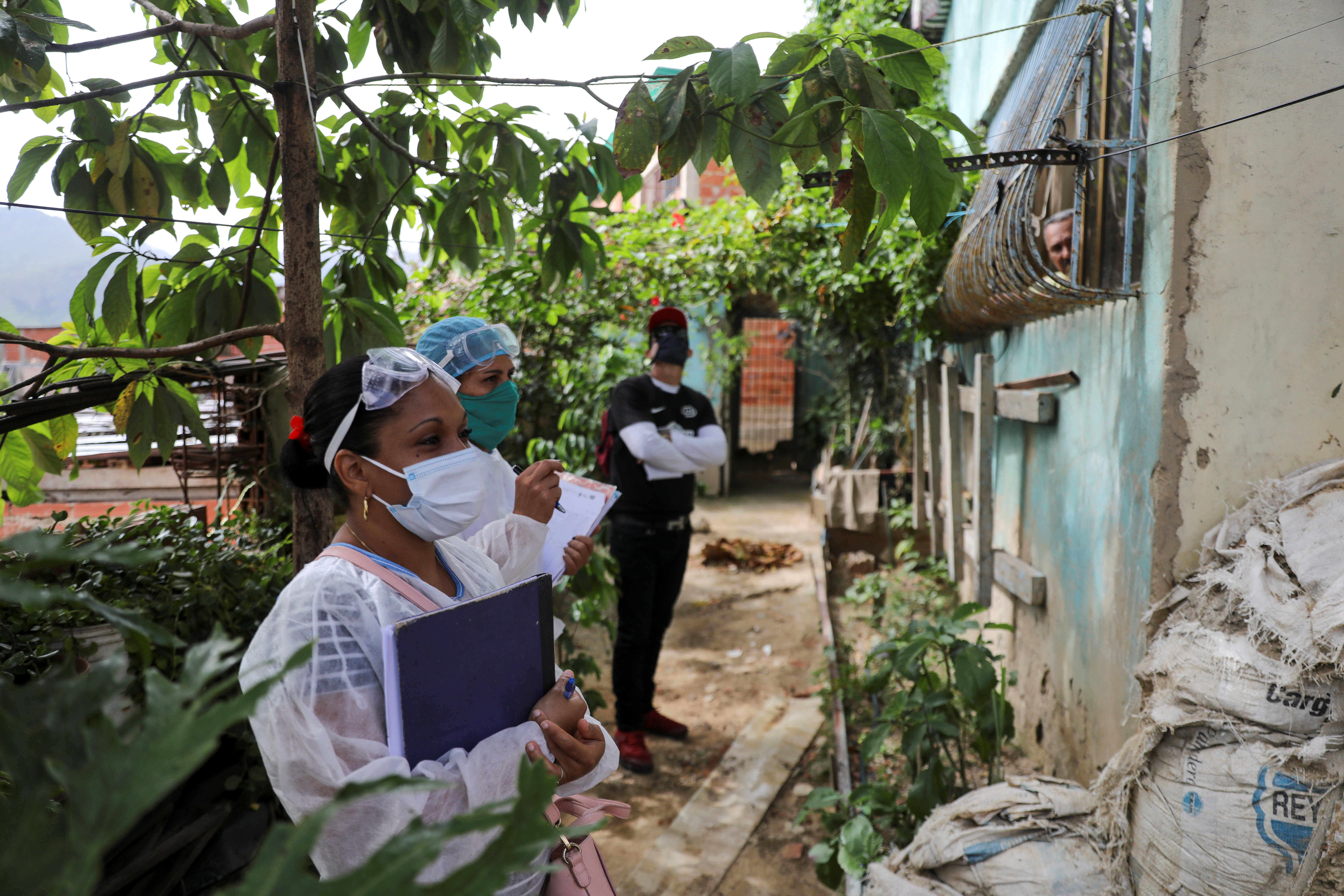 Doctors take a walking round at the low-income neighborhood of Las Mayas, as cases rise amid the coronavirus disease (COVID-19) outbreak, in Caracas, Venezuela July 14, 2020. Picture taken July 14, 2020