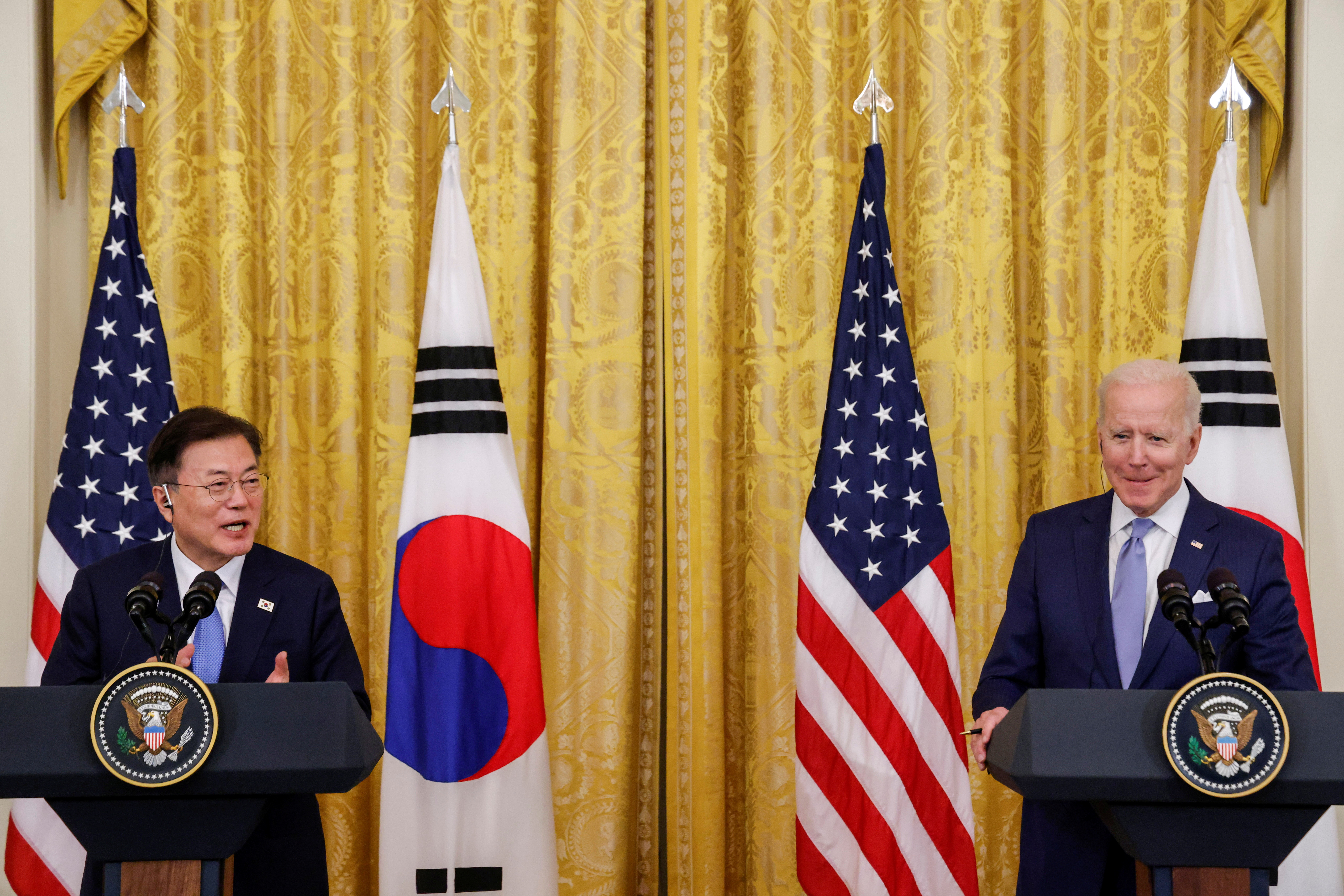 U.S. President Joe Biden reacts as South Korea's President Moon Jae-in speaks during a joint news conference after a day of meetings at the White House, in Washington, U.S. May 21, 2021.  REUTERS/Jonathan Ernst - RC2NKN9QTJNQ
