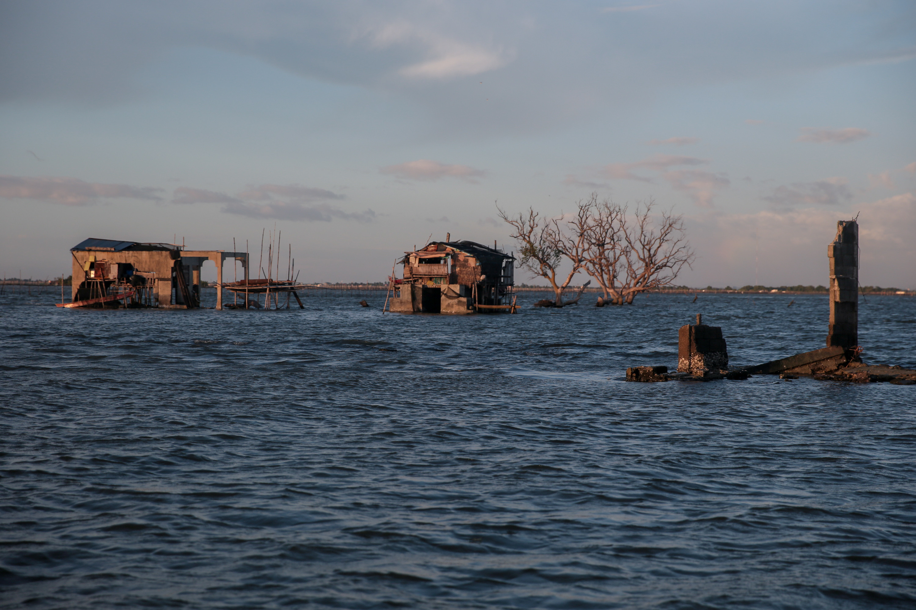 "Bamboo huts sit on top of concrete structures in the submerged coastal village Sitio Pariahan, Bulakan, Bulacan, north of Manila, Philippines, on November 27, 2019. REUTERS/Eloisa Lopez     SEARCH ""PHILIPPINES SINKING VILLAGE"" FOR THIS STORY. SEARCH ""WIDER IMAGE"" FOR ALL STORIES - RC2CLD9I8NET"