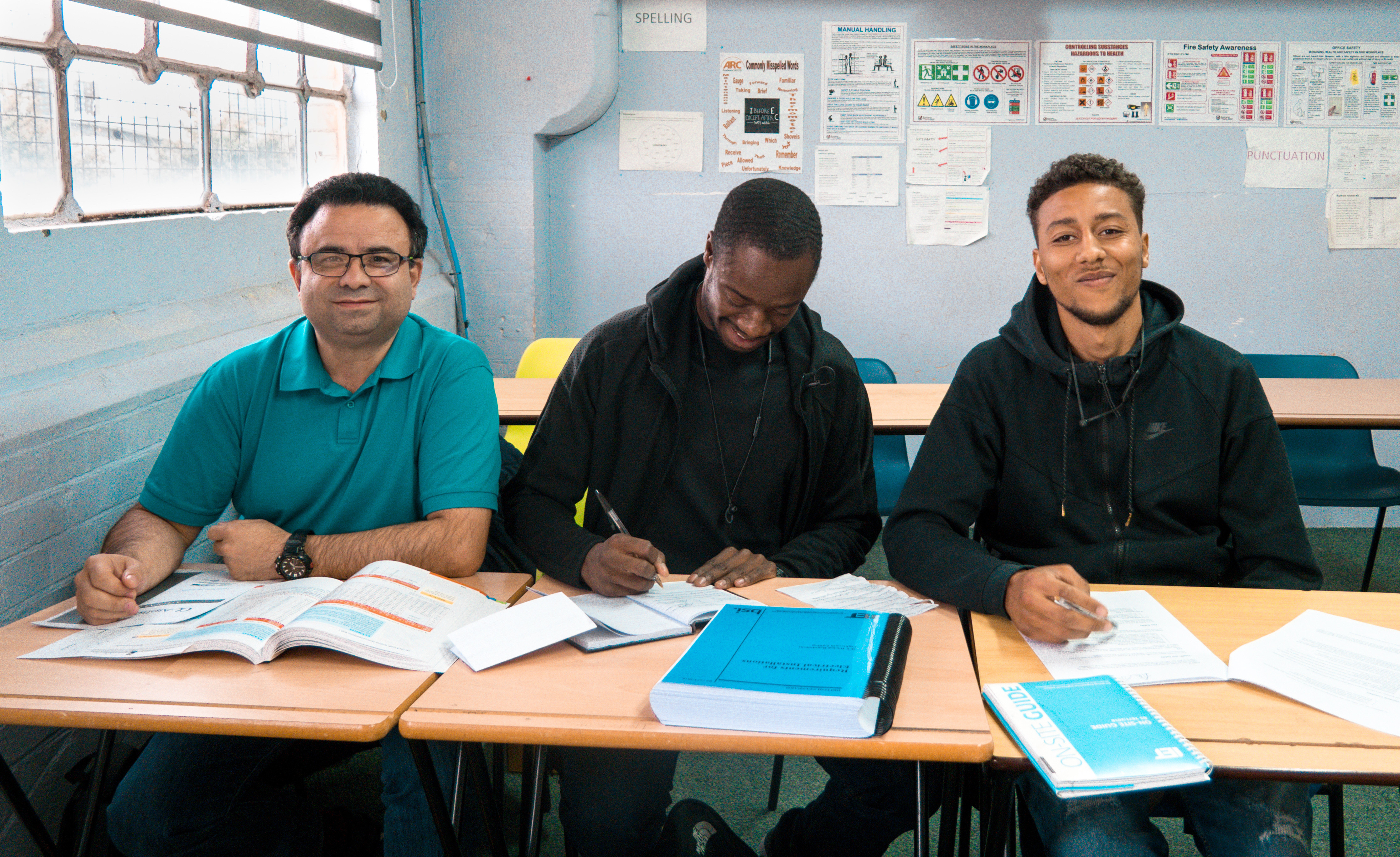 Hussein, Claude & Leo in training as electricians
