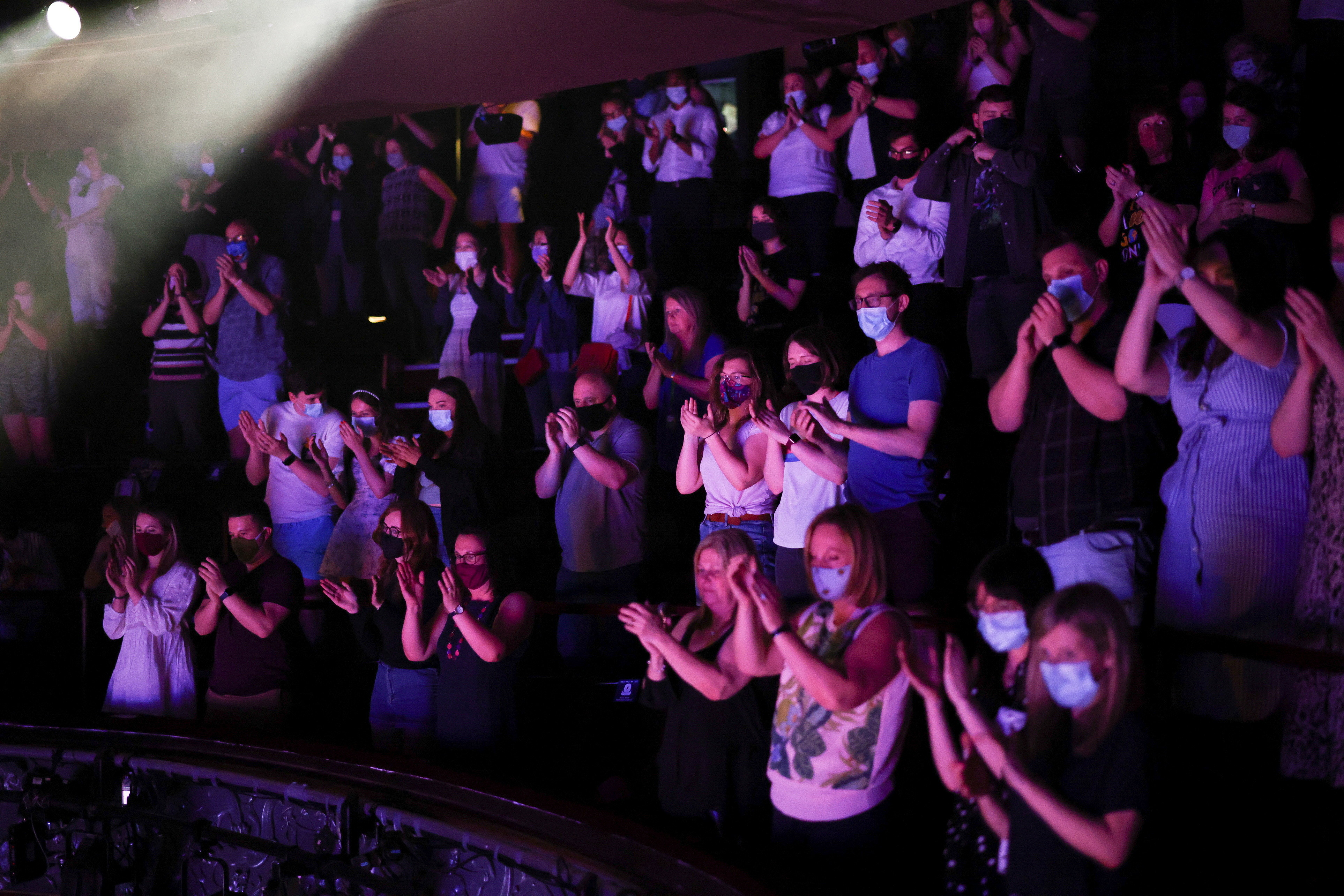 Guests applaud at the end of a performance of the West End show 'The Show Must Go On' at the Palace Theatre, amid the spread of coronavirus disease (COVID-19) in London, Britain, June 2, 2021. REUTERS/Henry Nicholls - RC2LSN9R713Q