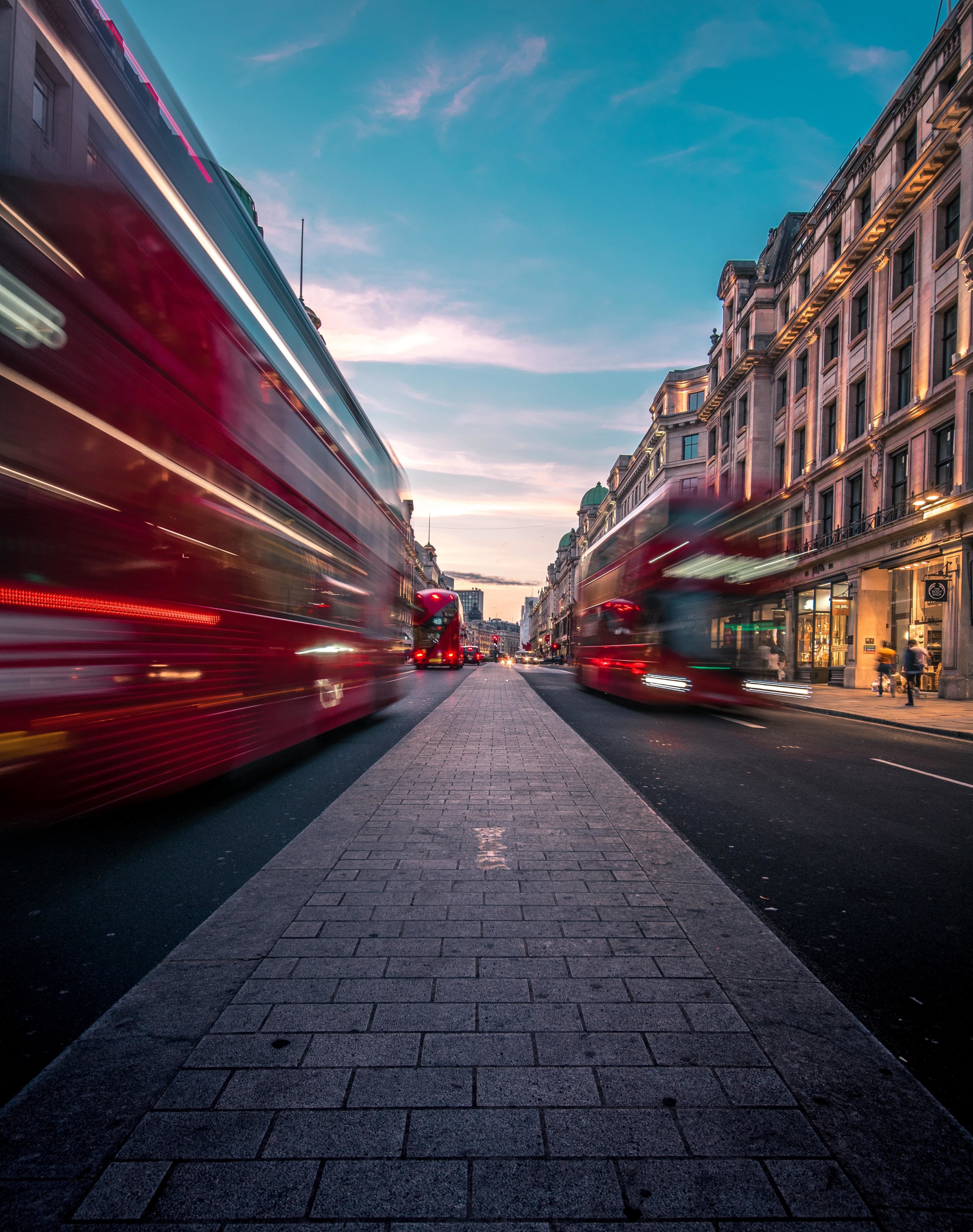 Buses travelling along Oxford St in London, United Kingdom.
