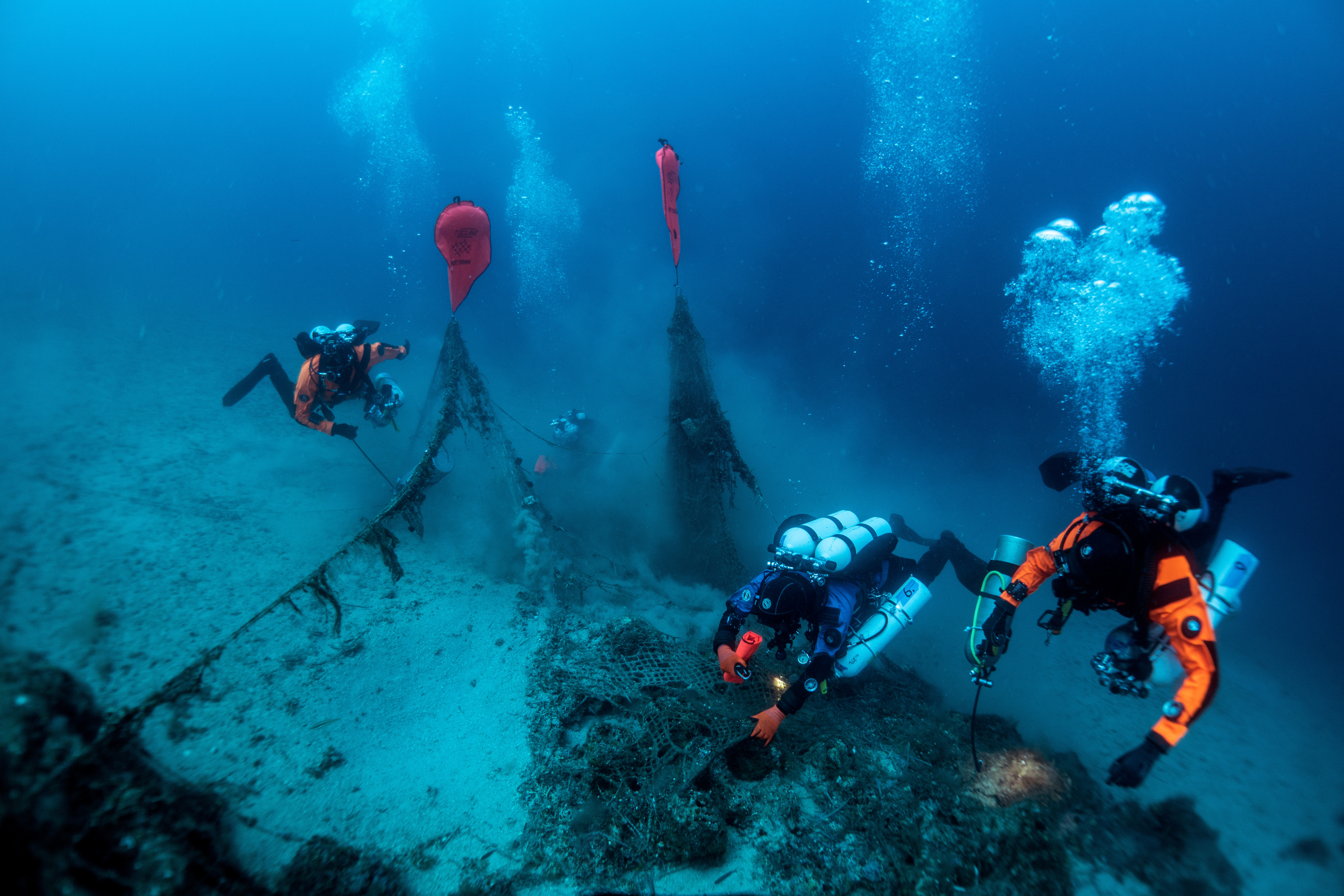 A group of underwater drivers excavate a shipwreck