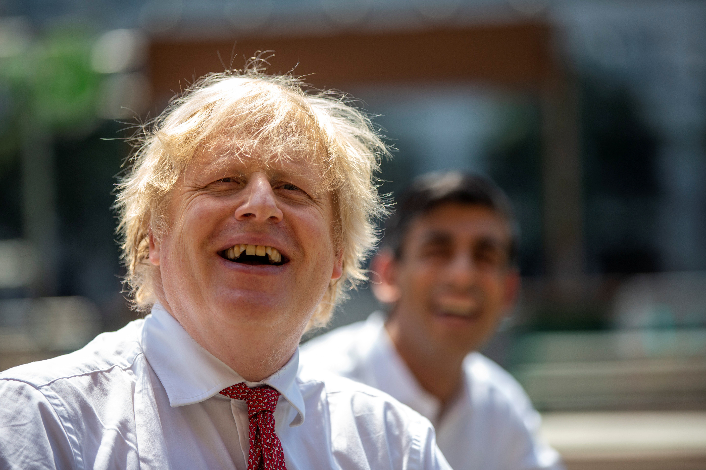 Britain's Prime Minister Boris Johnson and Chancellor Rishi Sunak visit Pizza Pilgrims in West India Quay, in London, Britian June 26, 2020. Heathcliff O'Malley/Pool via REUTERS - RC22HH9SCE28