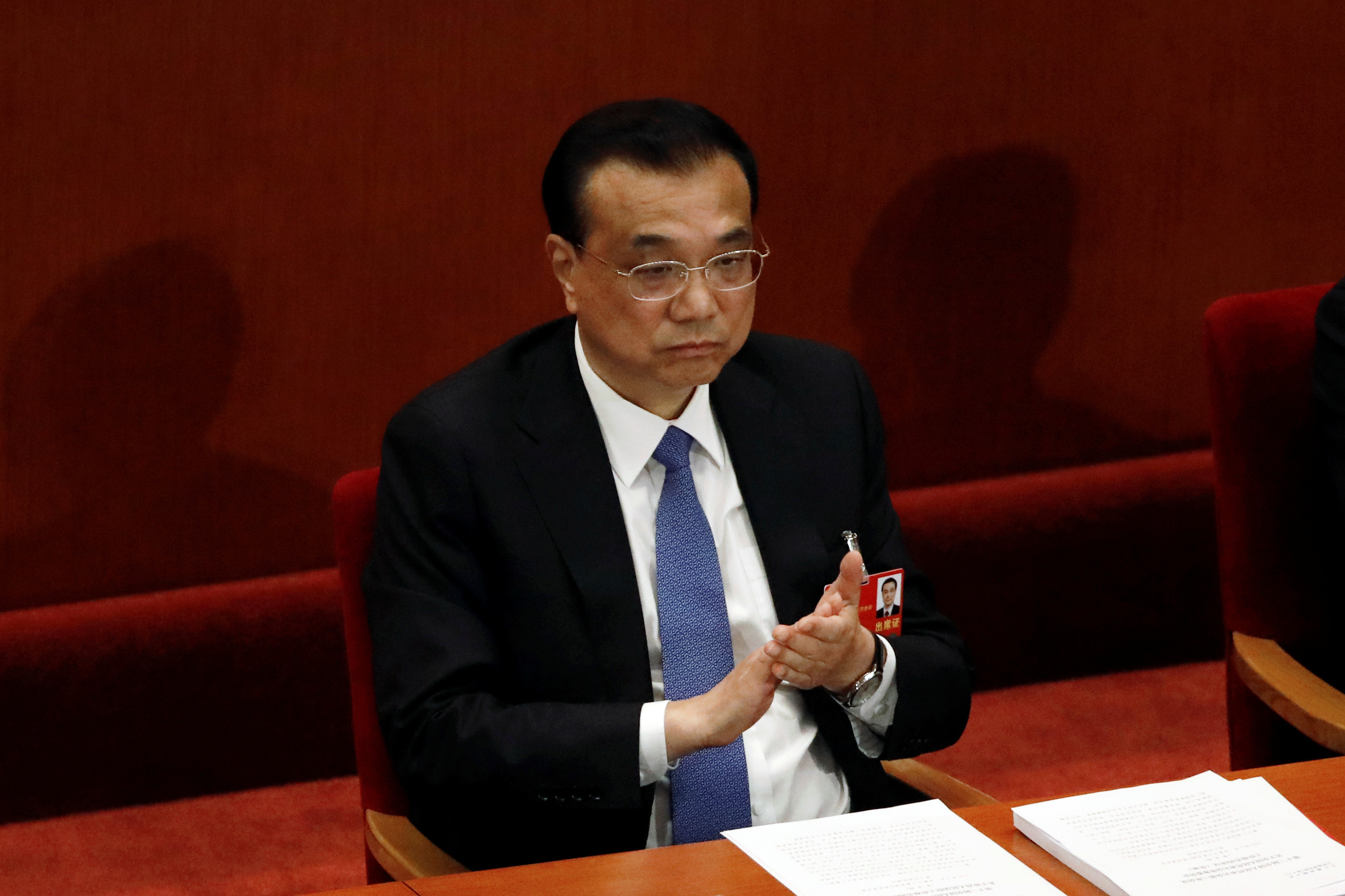 Chinese Premier Li Keqiang attends the closing session of the National People's Congress (NPC) at the Great Hall of the People in Beijing, China May 28, 2020. REUTERS/Carlos Garcia Rawlins - RC2LXG93Q12T