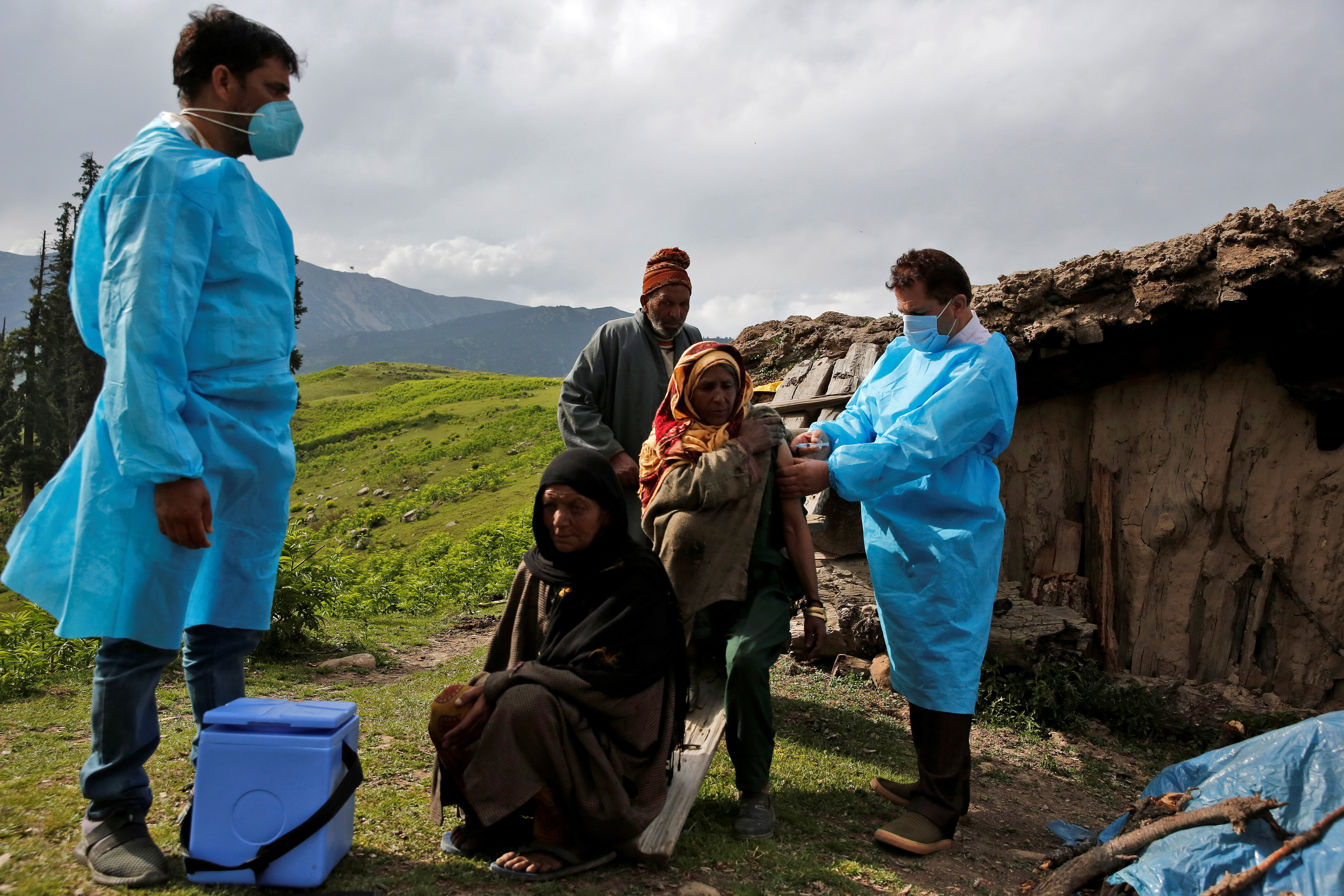 A shepherd woman receives a dose of COVISHIELD, a coronavirus disease (COVID-19) vaccine manufactured by Serum Institute of India, during a vaccination drive at Tosa Maidan in central Kashmir's Budgam district in India. June 21, 2021.