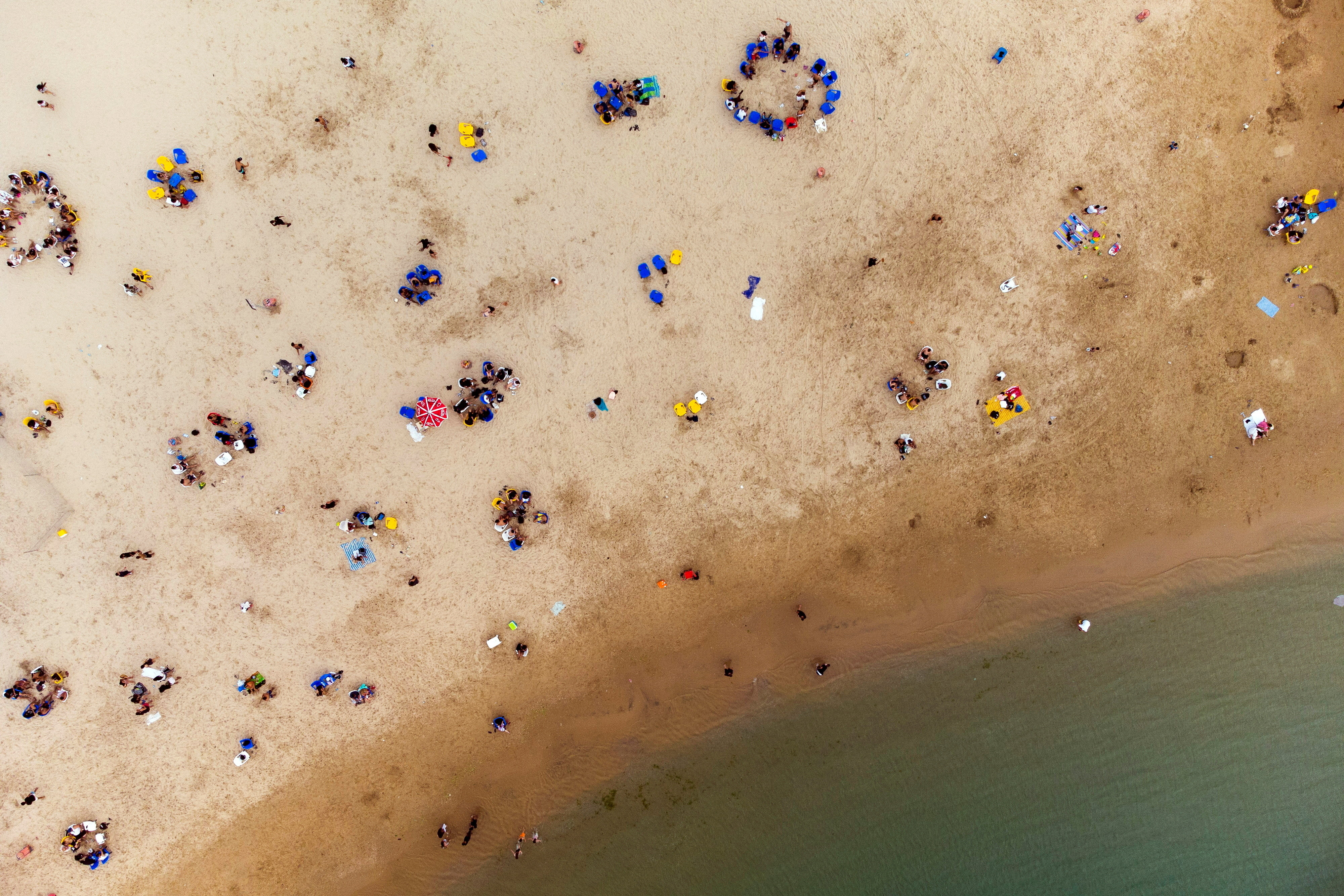 Israelis enjoy the beach of the Mediterranean during a heat wave as coronavirus disease (COVID-19) restrictions ease around the country, in Ashkelon Israel April 19, 2021.