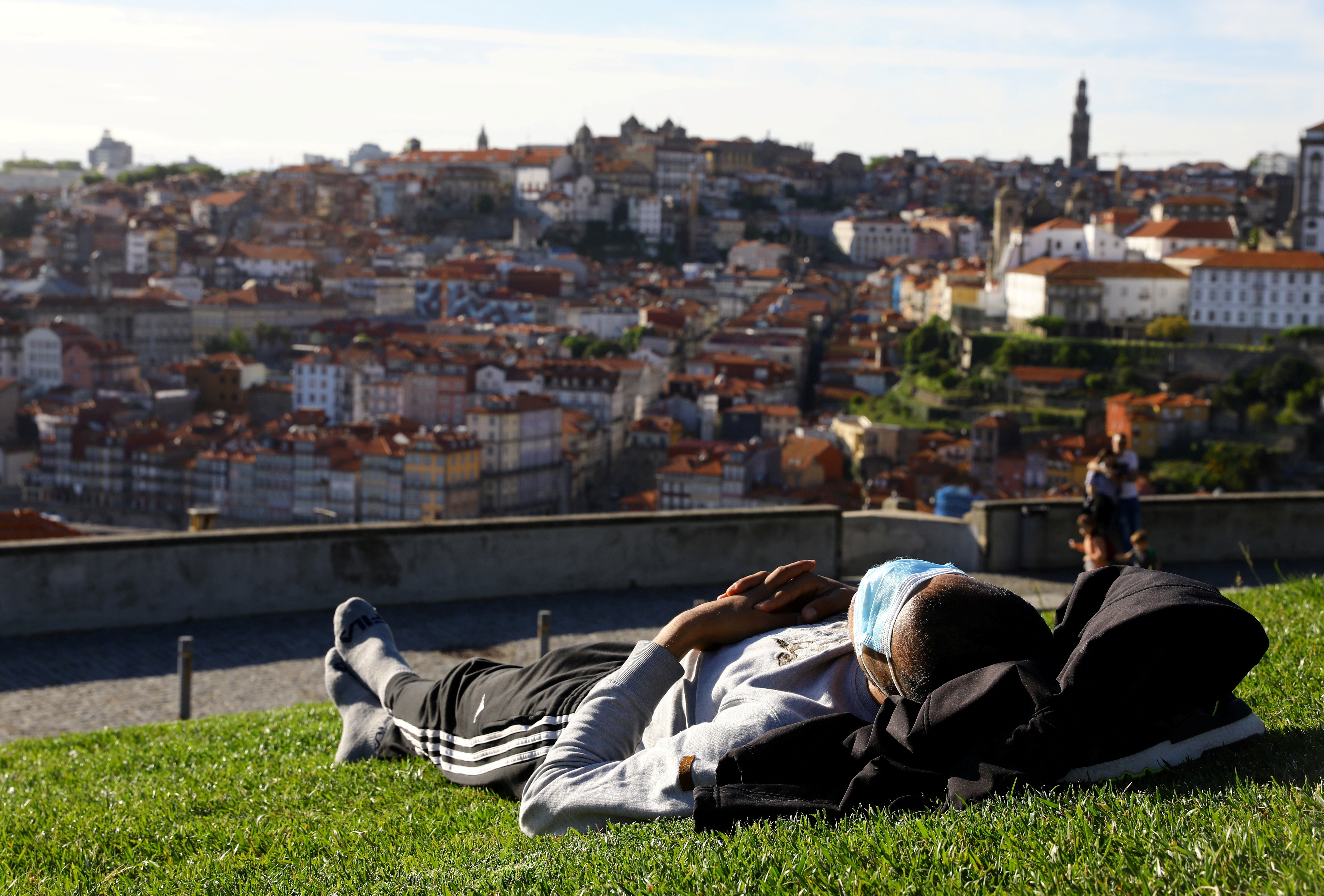 A man enjoys the sunny weather on the first day that tourists from Britain and most EU countries are allowed to enter Portugal without needing to quarantine, as coronavirus disease (COVID-19) restrictions continue to ease, in Vila Nova de Gaia, Portugal May 17, 2021. REUTERS/Violeta Santos Moura     TPX IMAGES OF THE DAY - RC2UHN9YUGC0