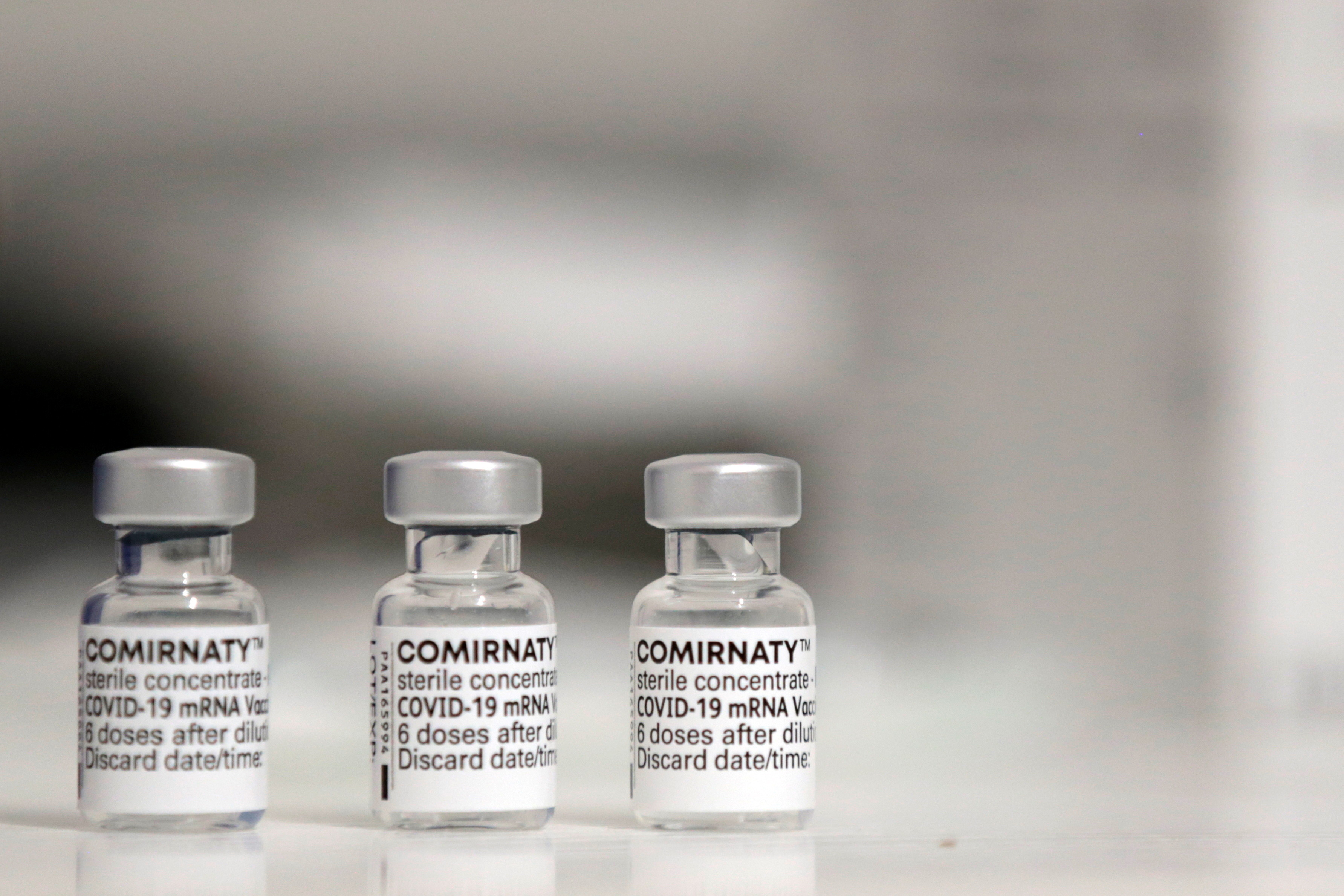 """Vials of the """"Comirnaty"""" Pfizer-BioNTech COVID-19 vaccine are seen at a coronavirus disease (COVID-19) vaccination center installated in front of Paris town hall, France, July 7, 2021. REUTERS/Sarah Meyssonnier - RC2OFO9B27A9"""