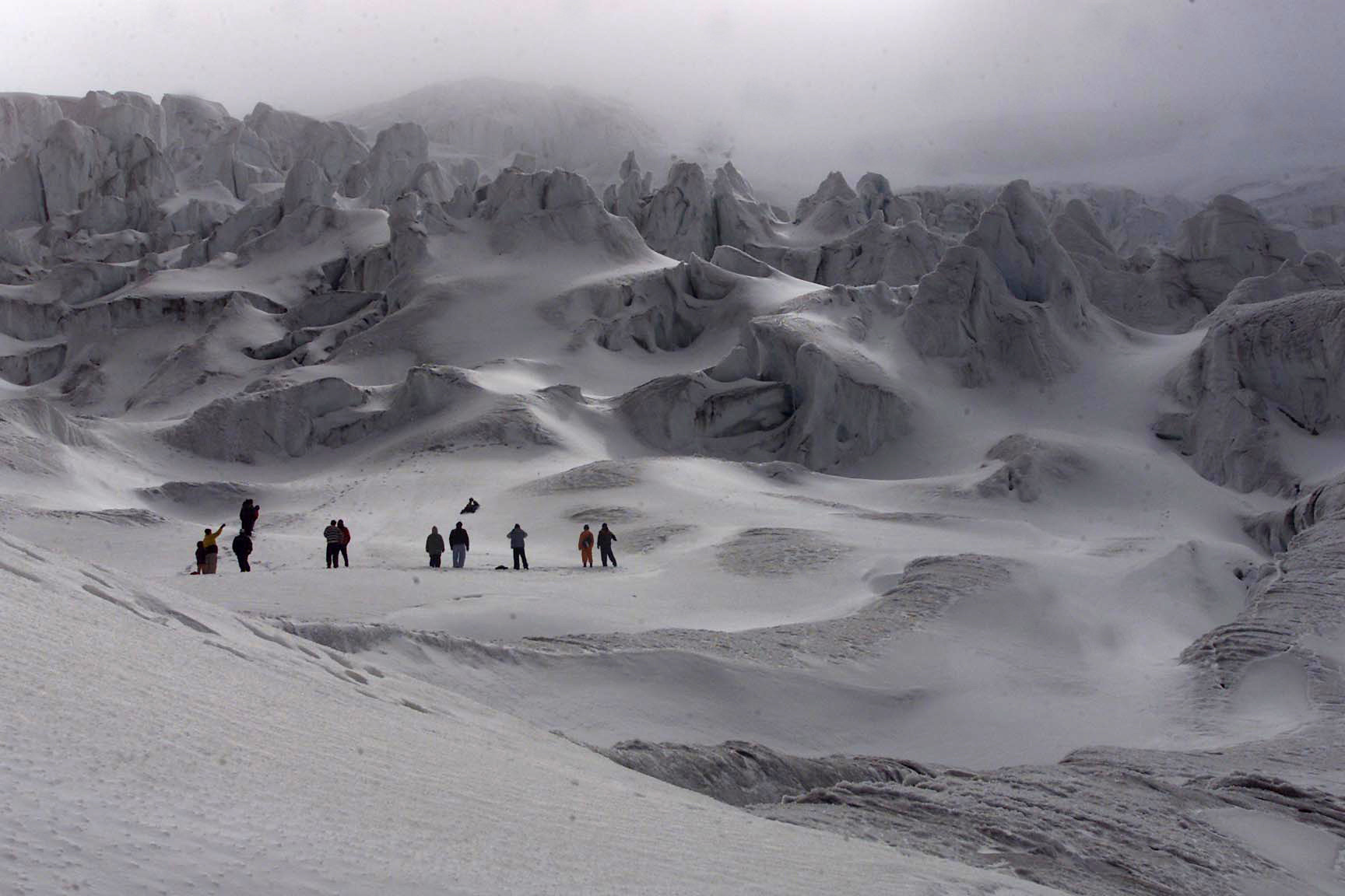people stand on a glacier