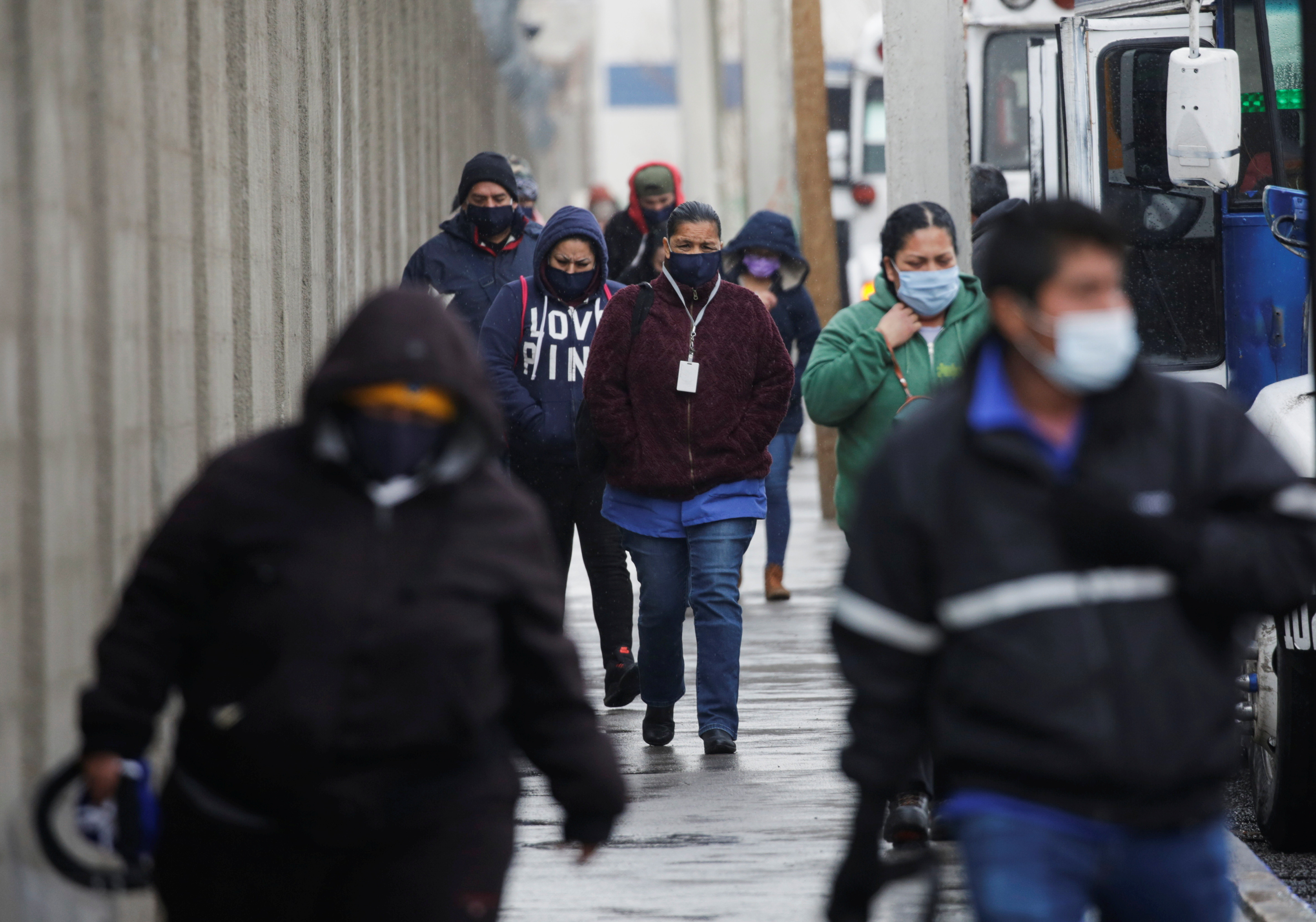 Employees of assembly factories are seen after their shift change during a cold front in Ciudad Juarez, Mexico February 16, 2021.