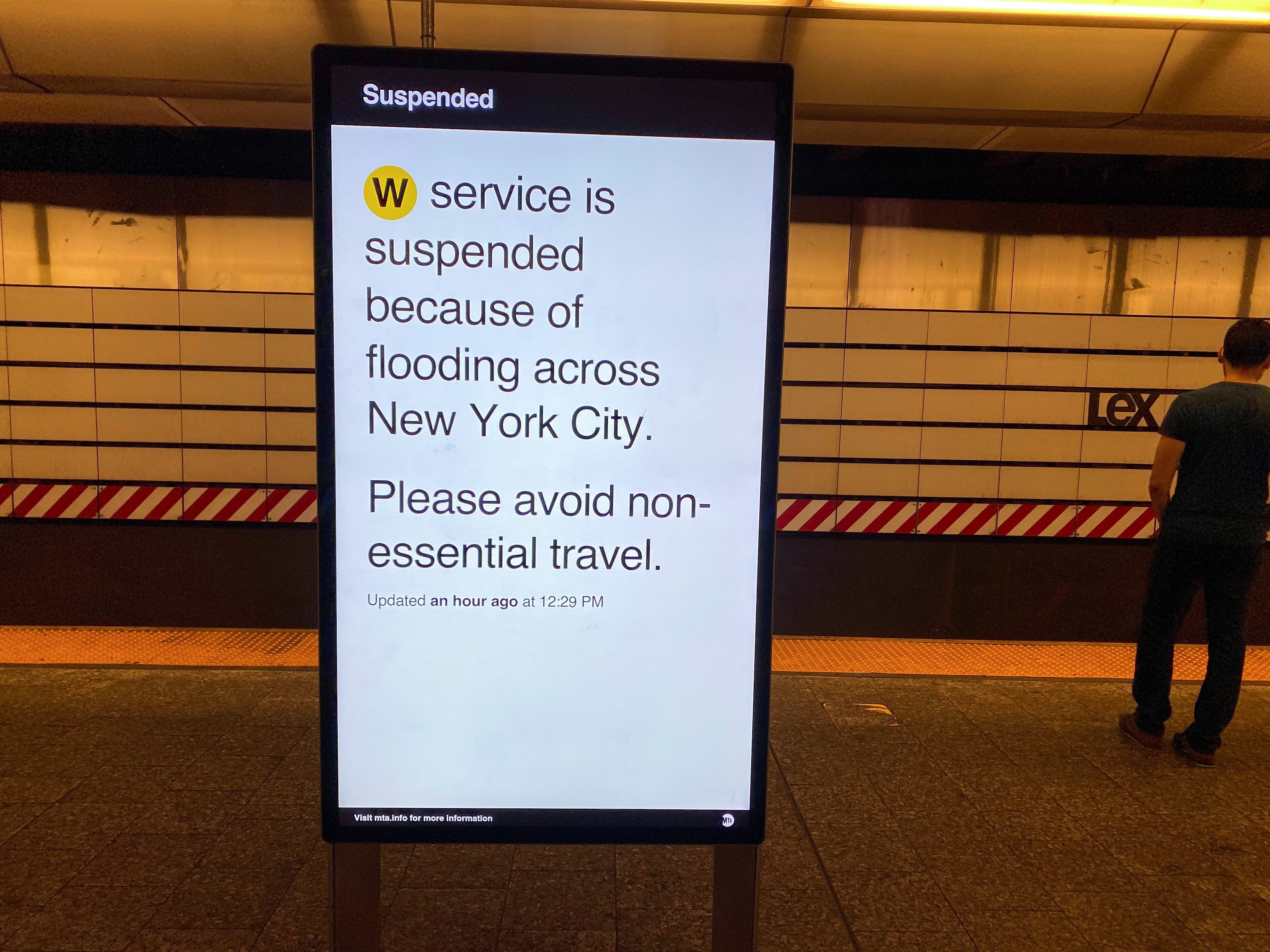 a subway service notice explains to travellers that the service is suspended due to flooding