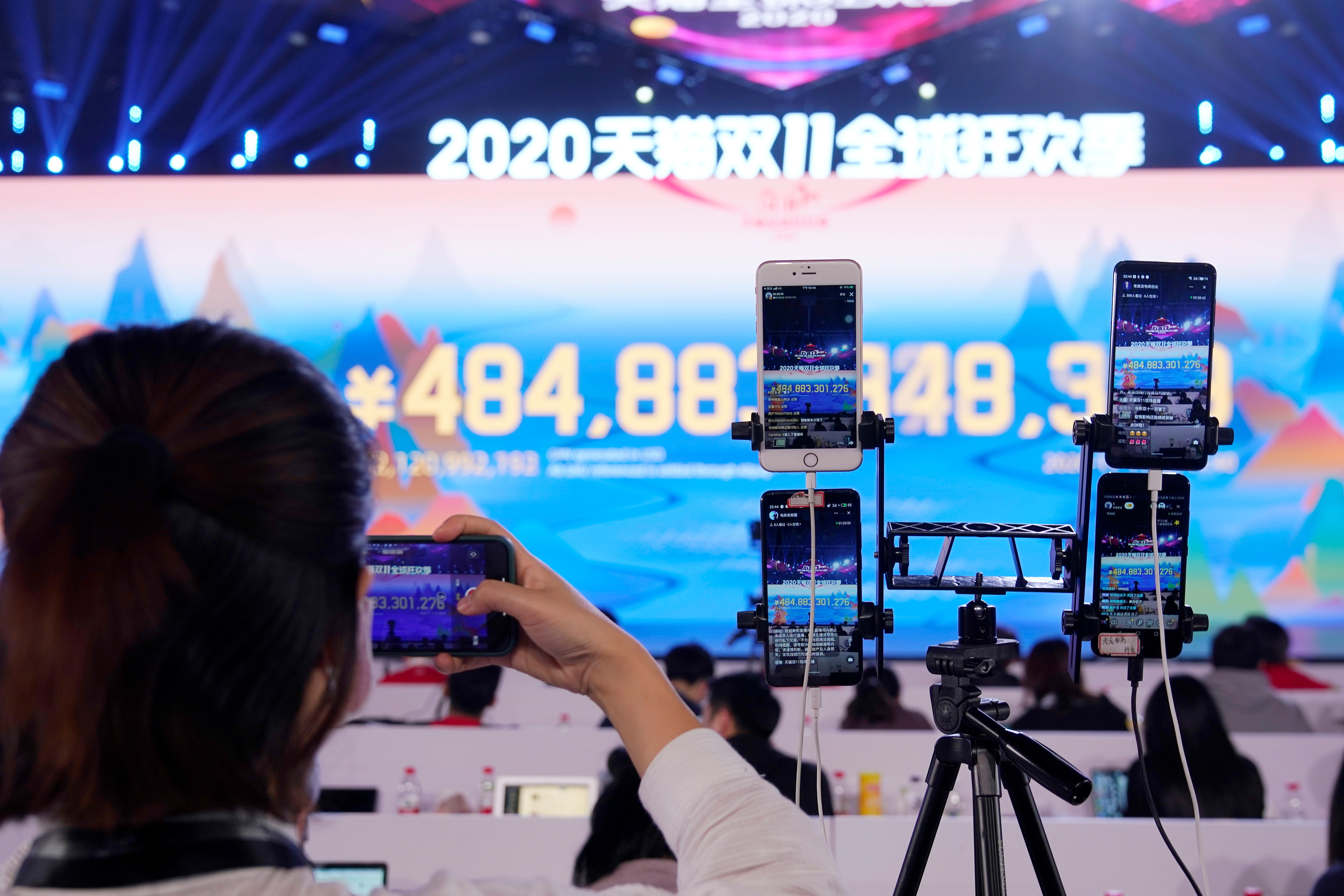 A live-streaming session through phones at Alibaba Group's Singles' Day global shopping festival at a media center in Hangzhou, Zhejiang province, China November 11, 2020.