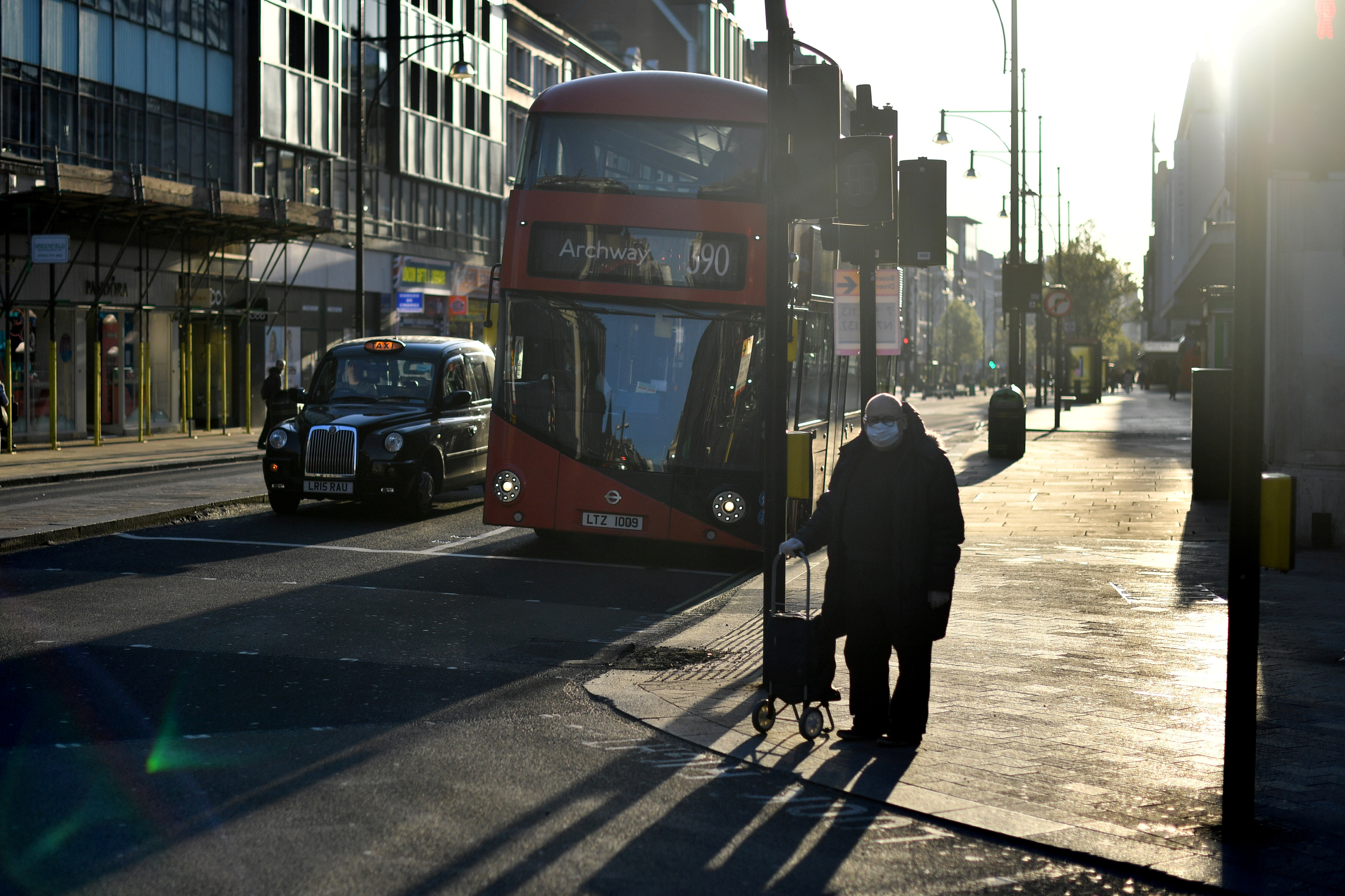 A man wearing a protective face mask in Oxford street during rush hour as the spread of the coronavirus disease.