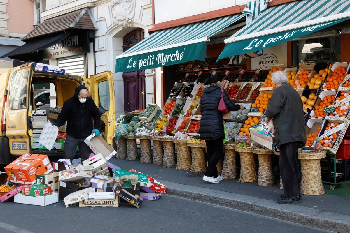 Local residents shop for fruit and vegetables at a mini market during the outbreak of Coronavirus disease (COVID-19) in Fontenay-sous-Bois, France, April 1, 2020.