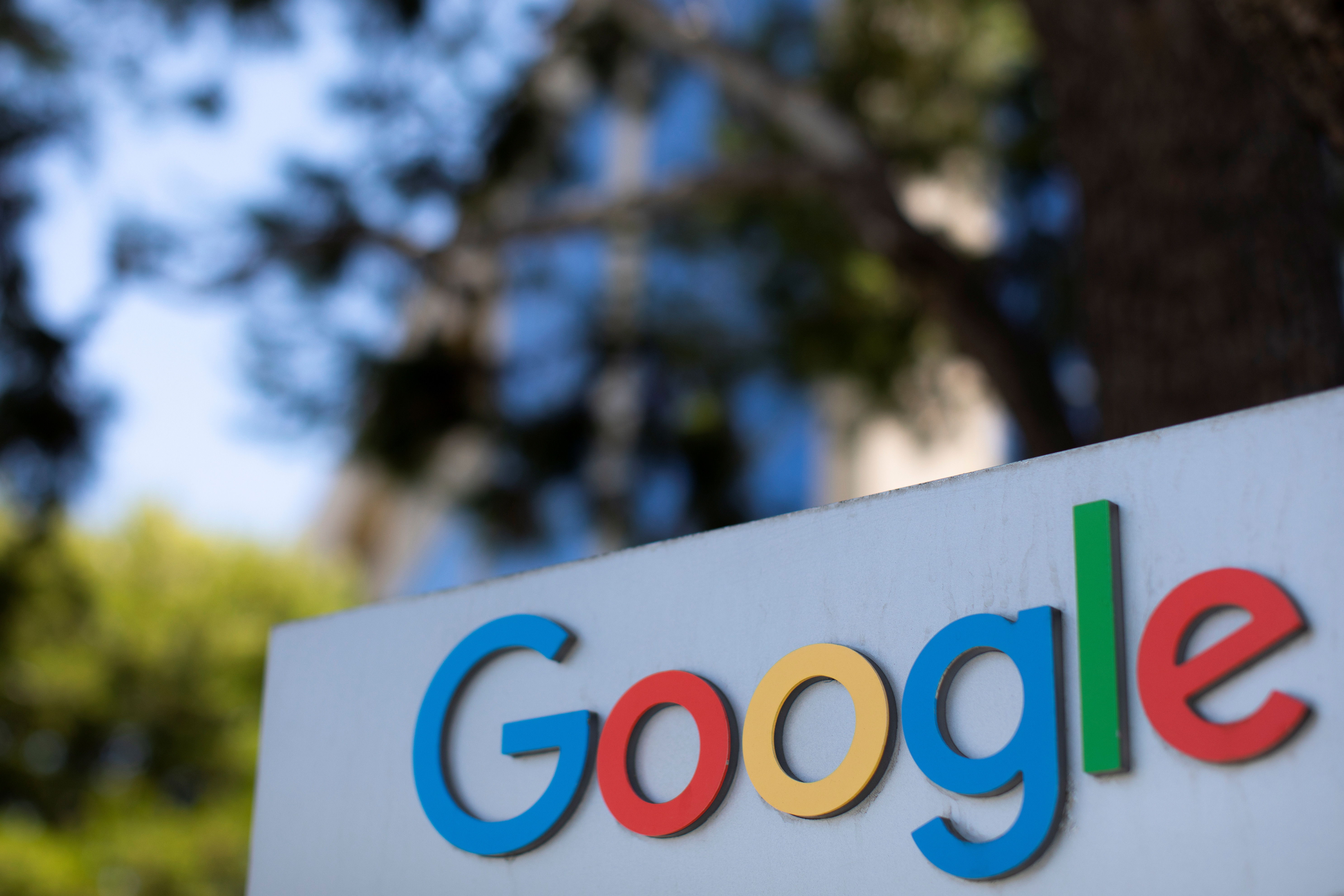 After the company announced it would extend its coronavirus work-from-home order until summer 2021, a  Google sign is shown at one of the company's office complexes in Irvine, California, U.S., July 27, 2020. REUTERS/Mike Blake - RC2W1I96ZPVR