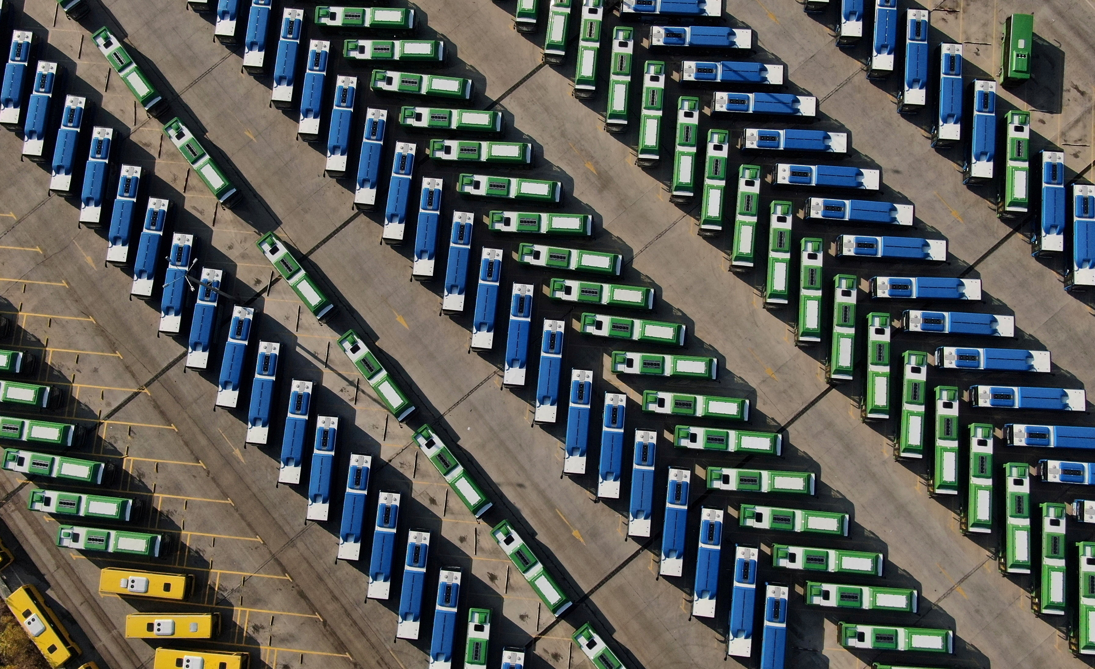 An aerial view shows buses parked in a depot after public transport was stopped, as Georgian government imposes stricter restrictions to stop the spread of the coronavirus disease (COVID-19), in Tbilisi, Georgia November 28, 2020. Picture taken with a drone. REUTERS/Irakli Gedenidze     TPX IMAGES OF THE DAY - RC2ACK9RZQSV