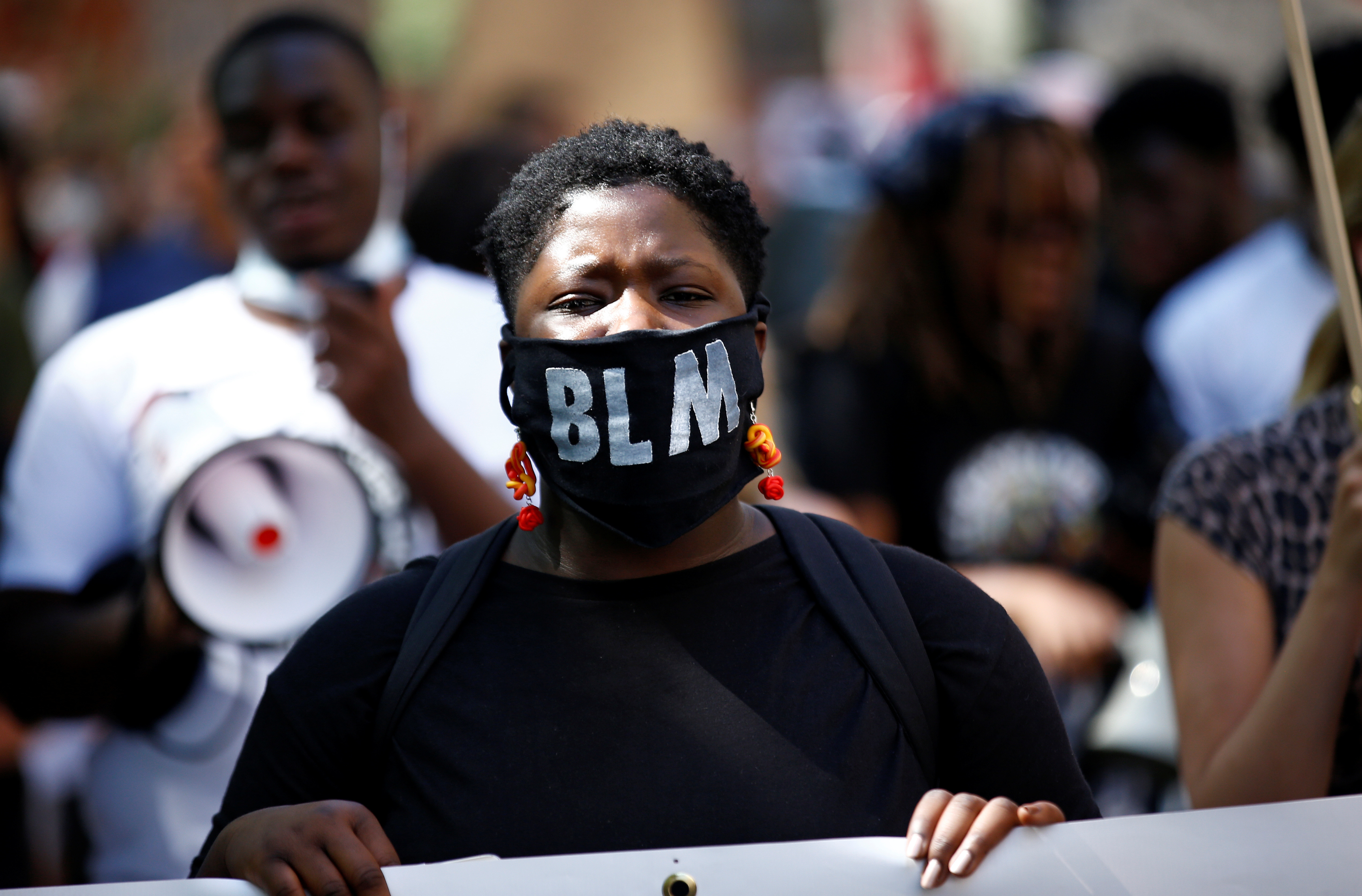 A demonstrator wearing a face mask marches during a Black Lives Matter protest in London, Britain, July 12, 2020