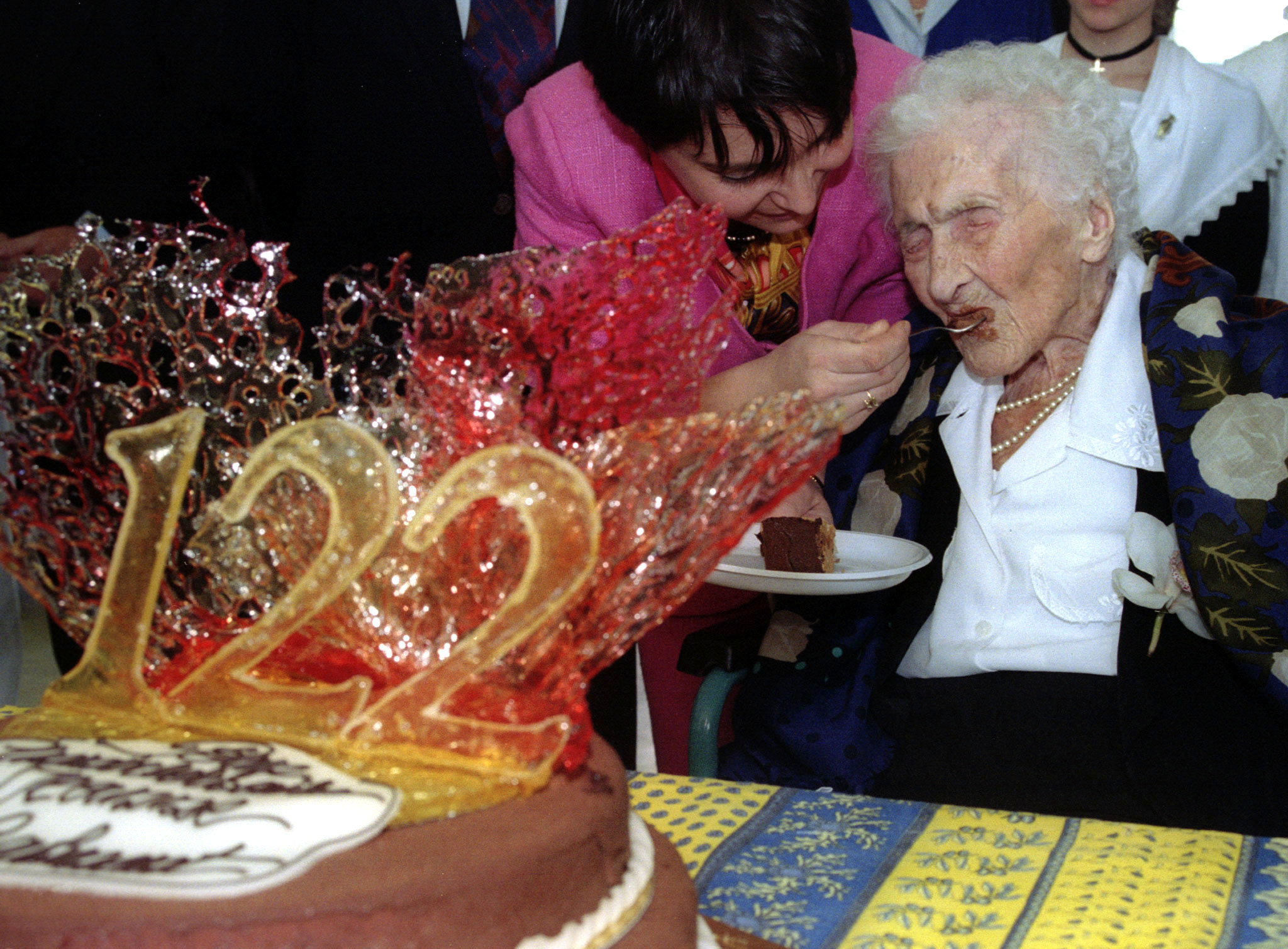 Frenchwoman Jeanne Calment, officially the world's oldest person, celebrates her 122nd birthday with a chocolate cake